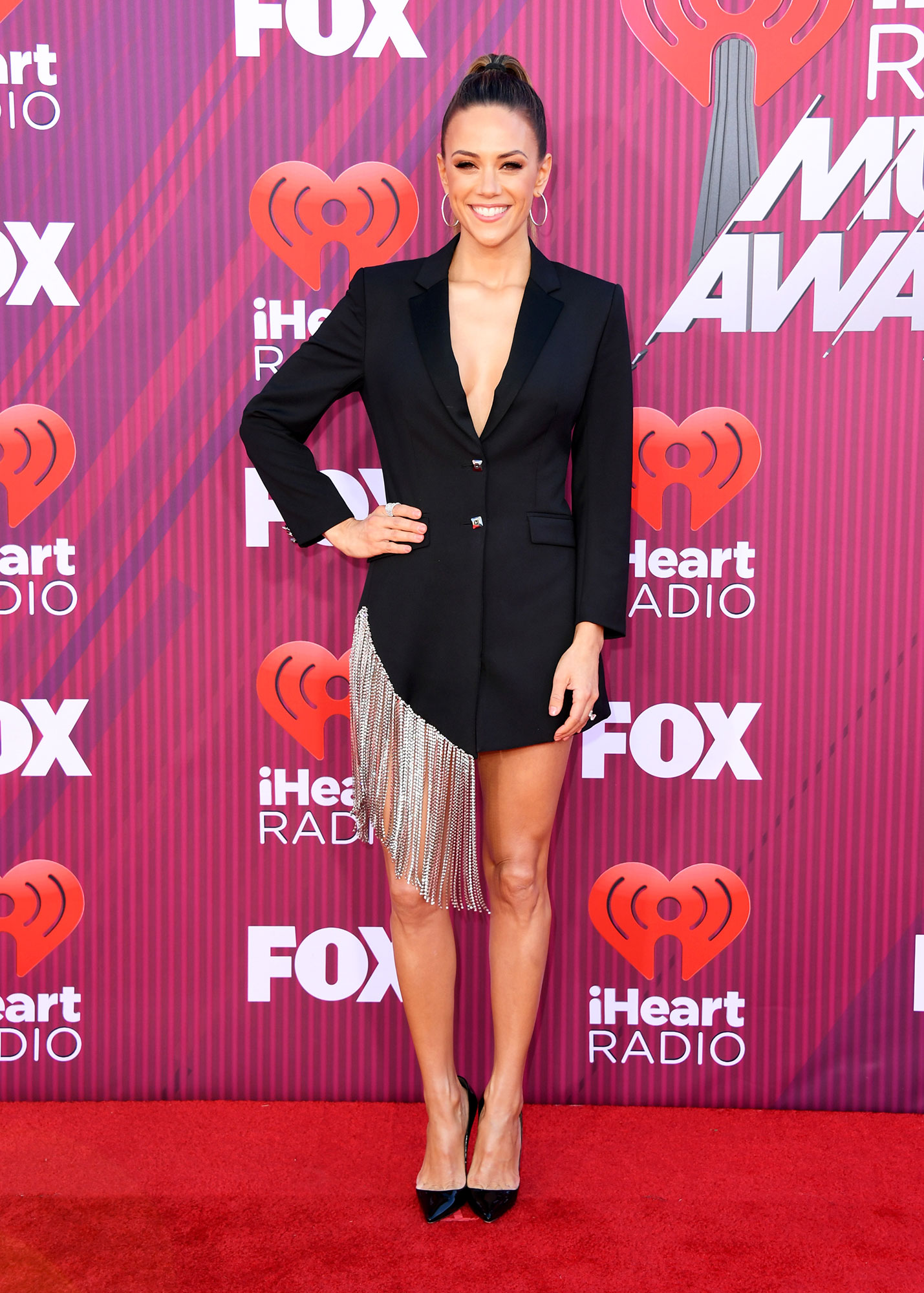 Jana Kramer See What the Stars Wore to the iHeart Radio Music Awards 2019 - Wearing a chain-adorned Philipp Plein minidress with Christian Louboutin heels, Sara Weinstock Jewelry hoops and an Effy Jewelry ring.