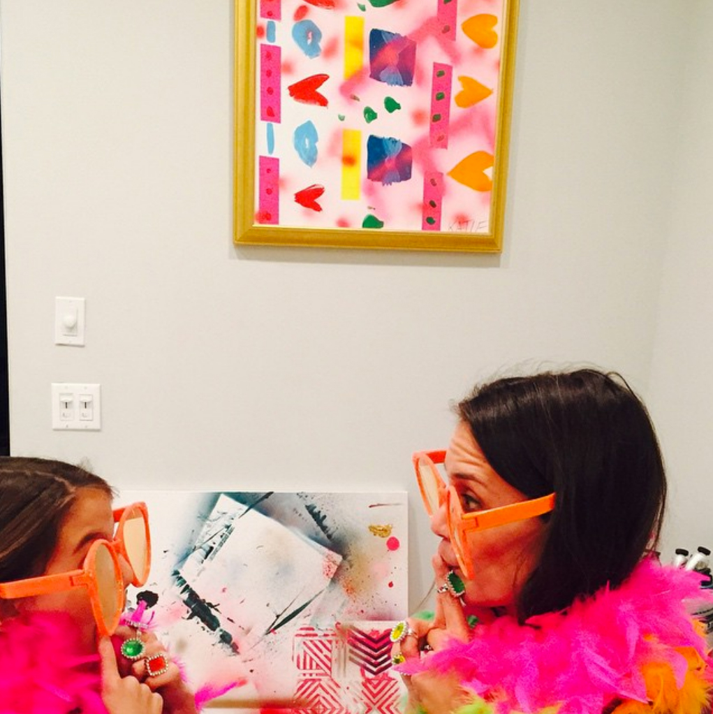 katie-holmes-suri-cruise-Having-a-Ball - Holmes and Suri showed off their silly side and played dress-up with neon feather boas and giant orange sunglasses in an April 2015 Instagram post.