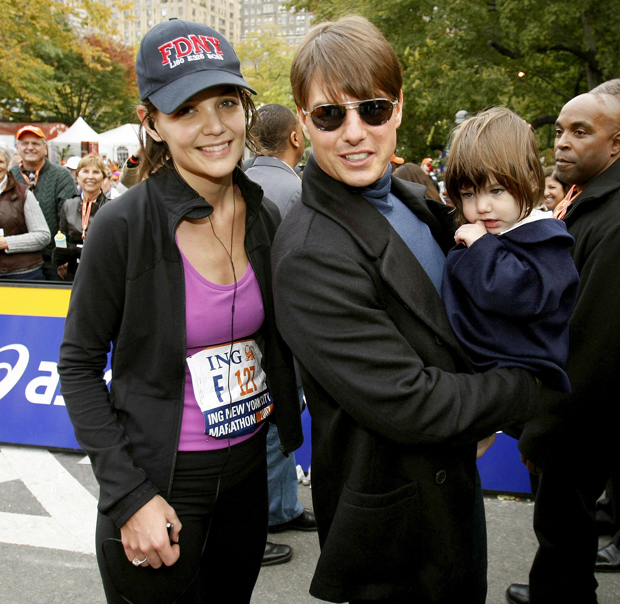 katie-holmes-suri-cruise-tom-cruise-Daddy's-Girl - Way back when she was just a toddler, Suri waited at the finish line with the Top Gun star to greet Holmes after she finished running the 2007 New York City Marathon.