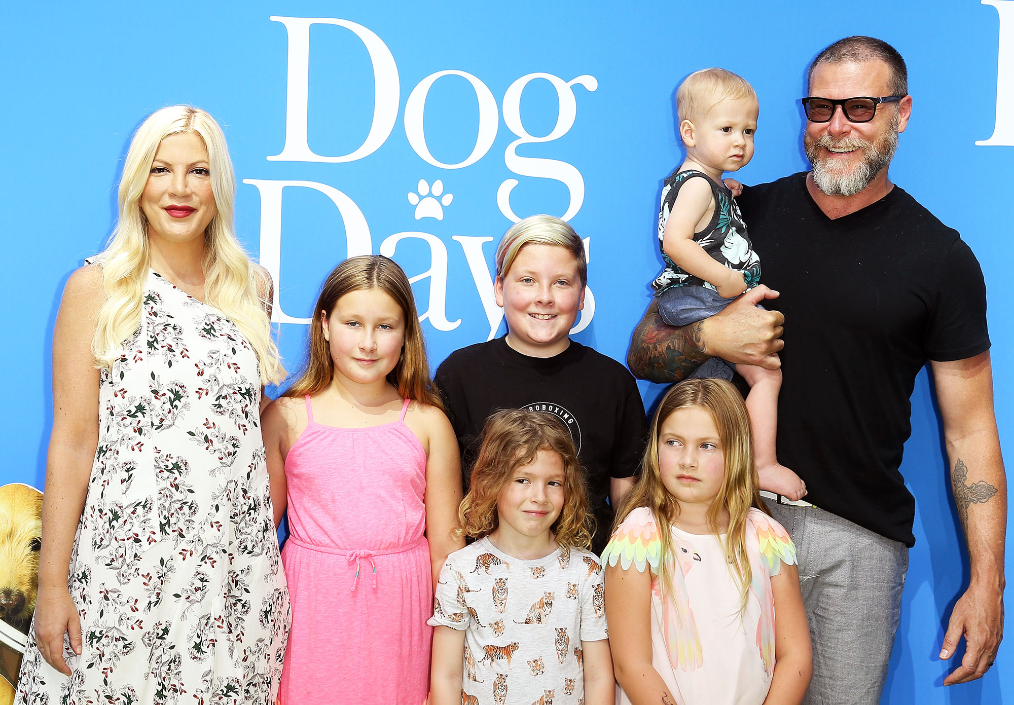 "How Tori Spelling, Dean McDermott Keep Their Romance Alive: I Have to Touch Her Butt Every Day. - Tori Spelling with Dean McDermott and their children attend the Los Angeles premiere of LD Entertainment's ""Dog Days"" held at Westfield Century City on August 5, 2018 in Century City, California."