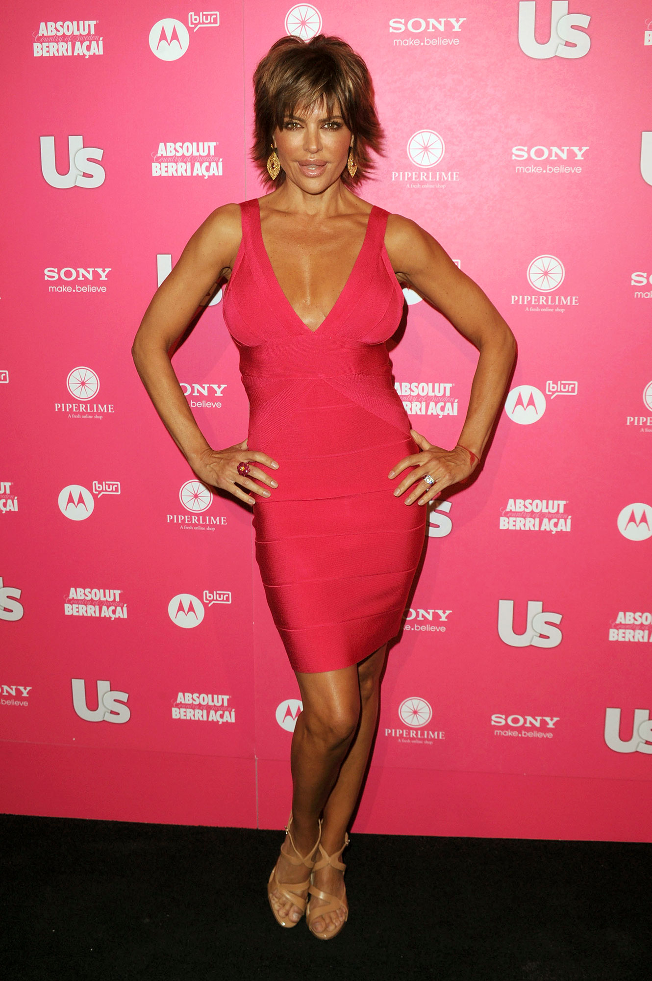 """Lisa Rinna's Most Savage Comebacks - Rinna clapped back at a Twitter troll who criticized her surgically enhanced pout . """"Sorry Lisa, but your lips look awful … How on Earth do you think that looks good?"""" the hater asked in April 2010."""