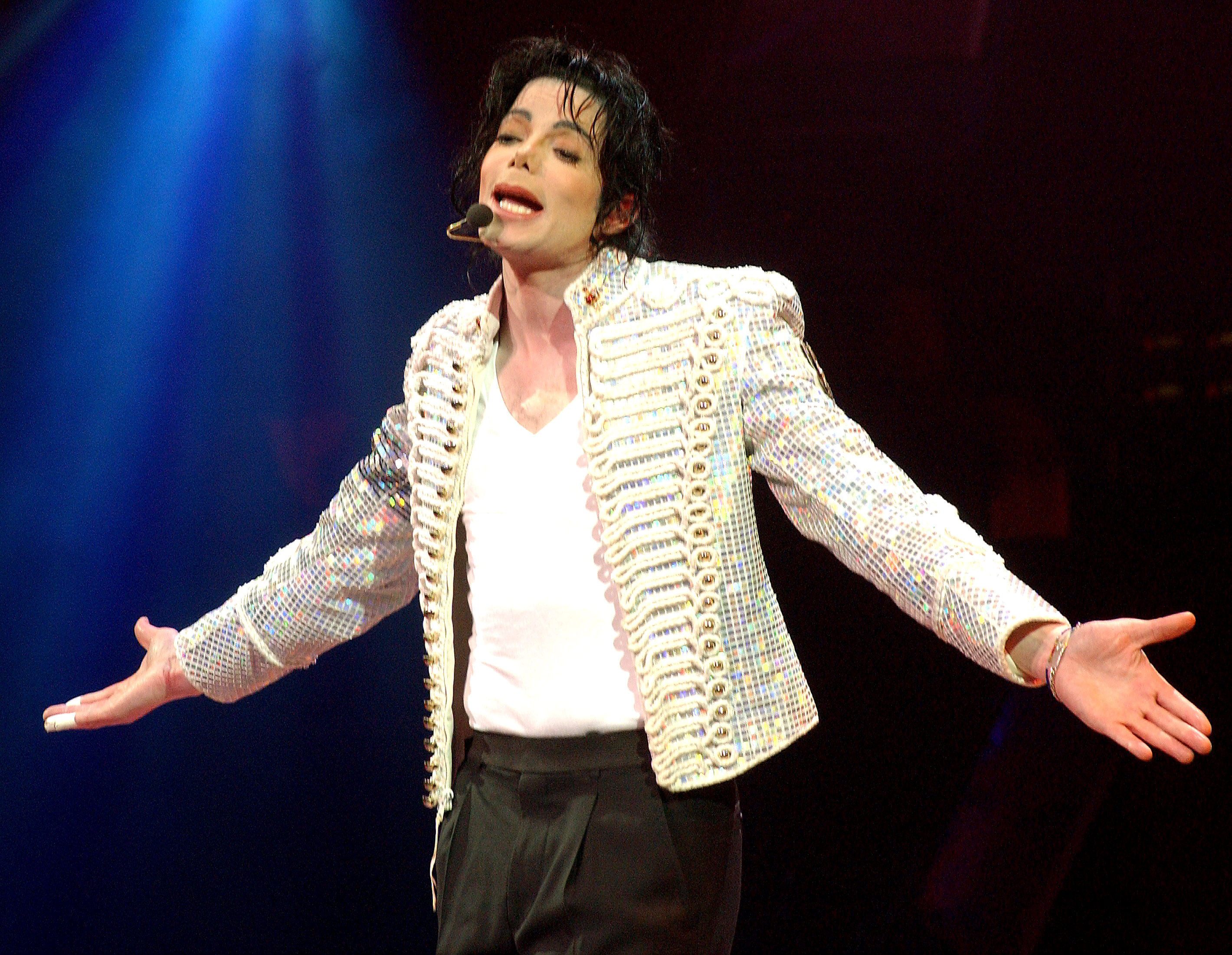 """Michael Jackson's Kids: Where Are They Now? - UNITED STATES – APRIL 24: Michael Jackson performs onstage during """"A Night At The Apollo,"""" a Democratic National Committee fundraiser at the Apollo Theater to kick off the """"Every Vote Counts"""" national voter registration drive."""