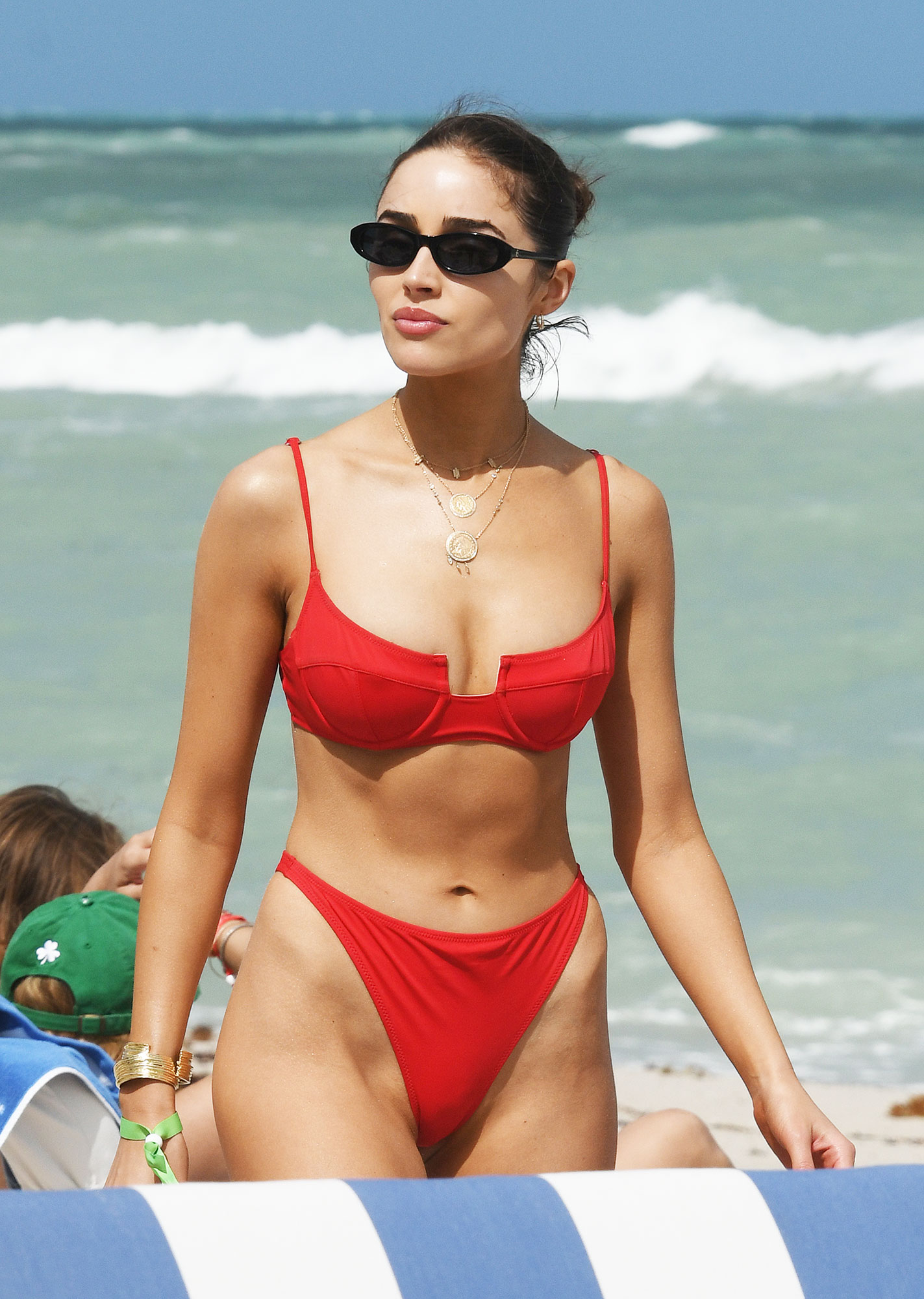 Olivia Culpo and Gigi Hadid Make the Case for Primary Color Bikinis - Olivia Culpo stands out in a red bikini as she hits the beach with model Devon Windsor in Miami. 28 Mar 2019