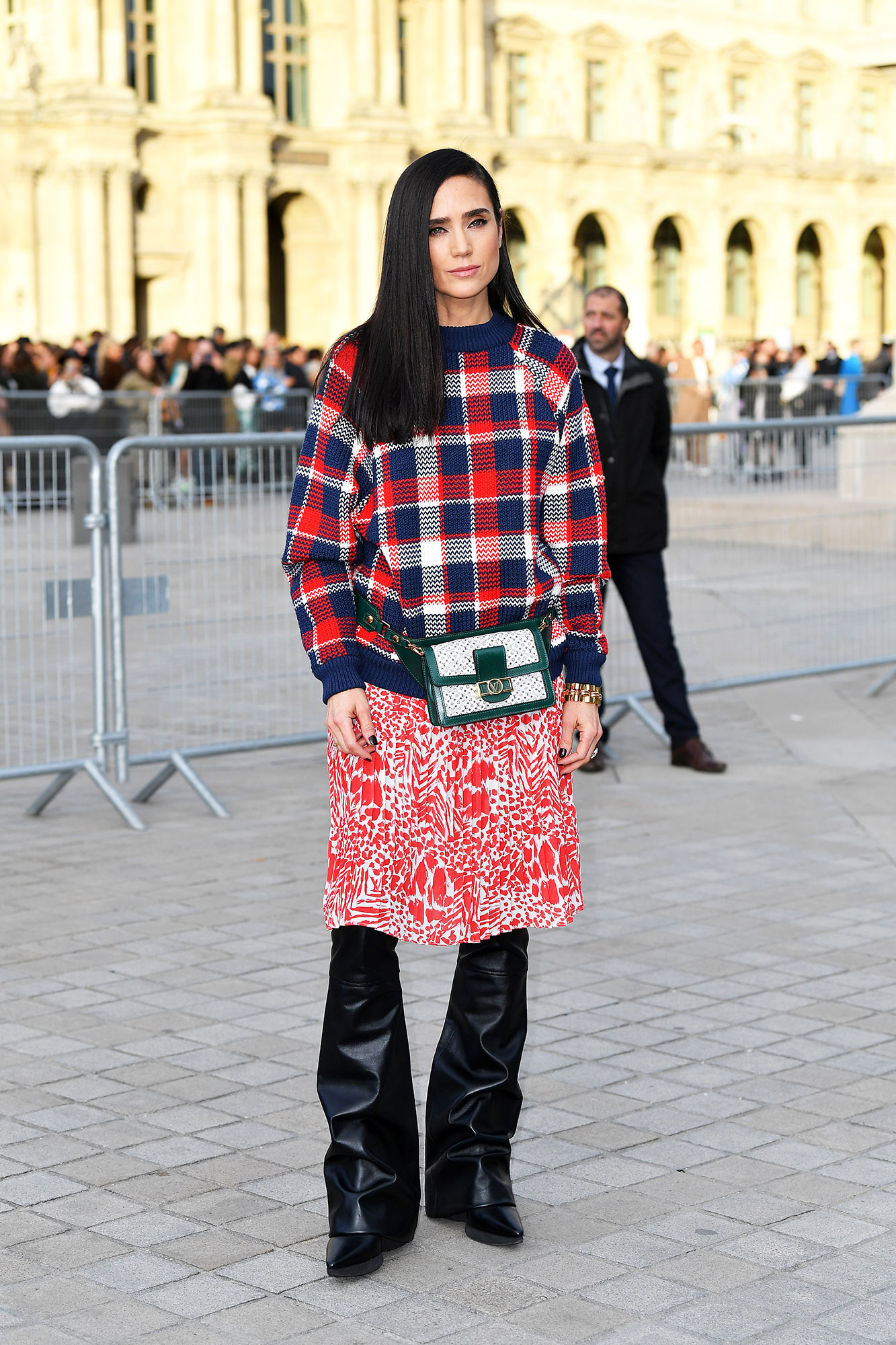Jennifer Connelly Stars Closed Out Paris Fashion Week on a Sartorial High Note - When in doubt, layer a plaid sweater over your printed skirt and leather pants as the actress did at Louis Vuitton on Tuesday, March 5.