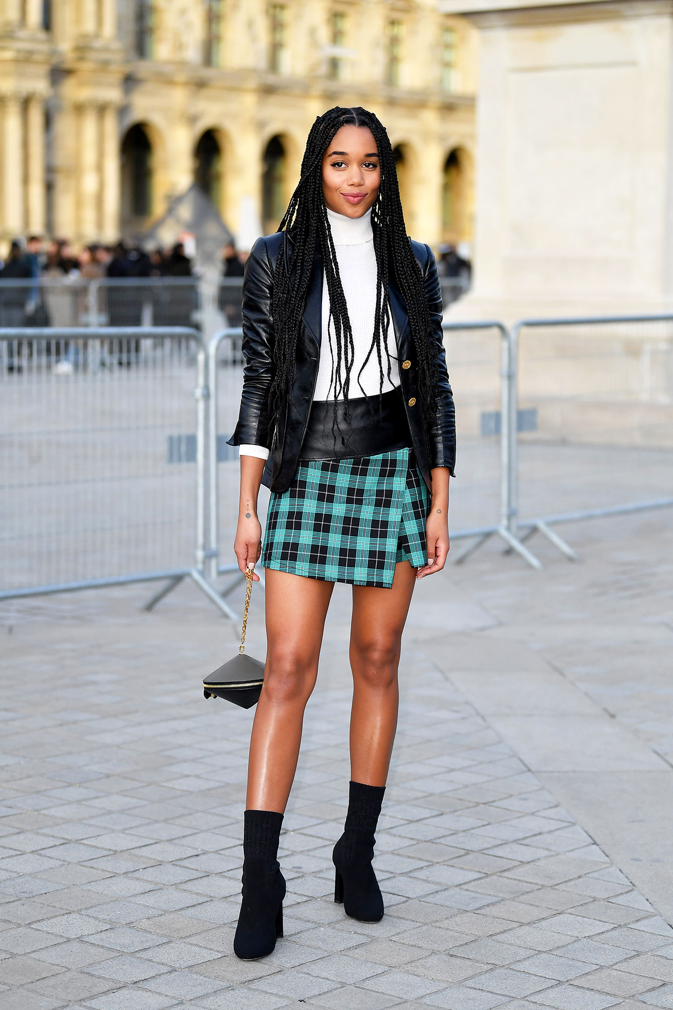 Laura Harrier Stars Closed Out Paris Fashion Week on a Sartorial High Note - After rocking Louis Vuitton on the red carpet all awards season, the BlackKklansman actress showed some leg in a plaid miniskirt at the fashion house's show on Tuesday, March 5.