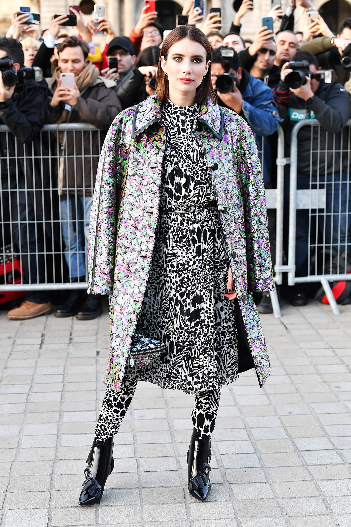 Emma Roberts Stars Closed Out Paris Fashion Week on a Sartorial High Note - Who says you can't mix prints? The actress was all about pattern play at the Louis Vuitton show on Tuesday, March 5.