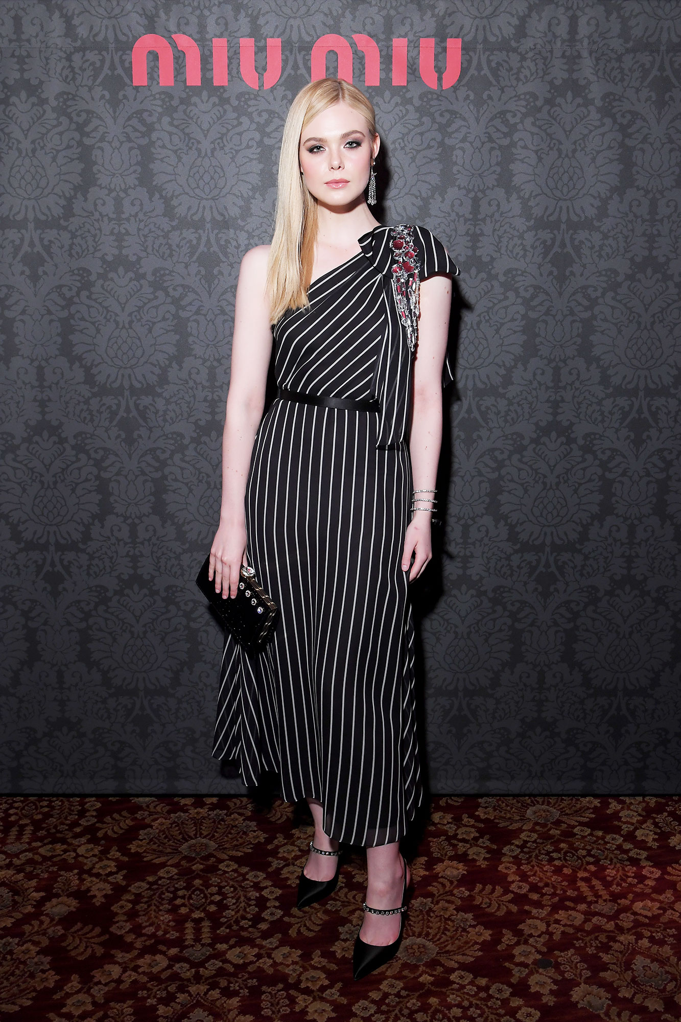 Elle Fanning Stars Closed Out Paris Fashion Week on a Sartorial High Note - The Miu Miu brand ambassador was cute in an asymmetrical striped frock at the brand's party on Tuesday, March 5.