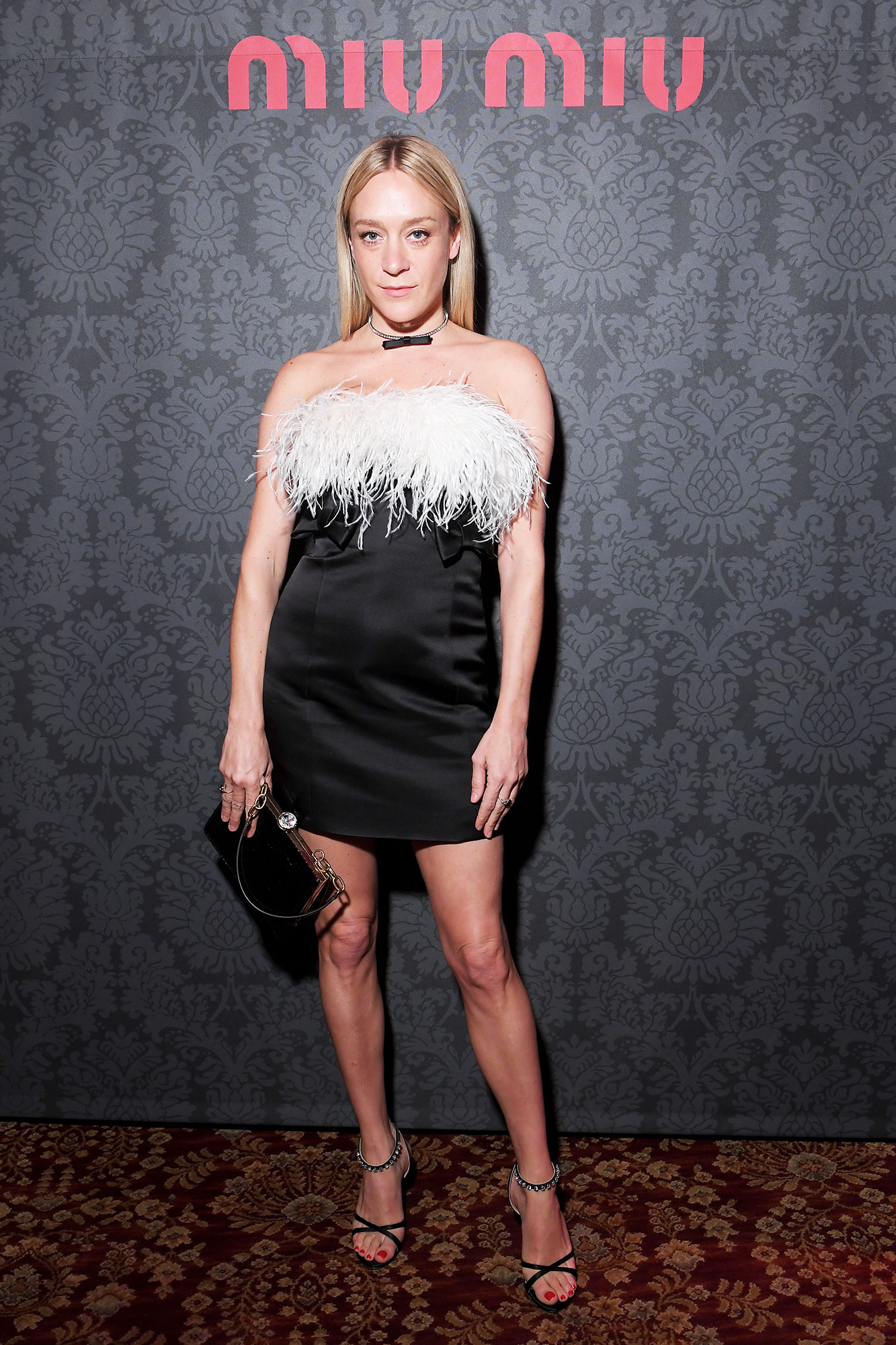 Chloe Sevigny Stars Closed Out Paris Fashion Week on a Sartorial High Note - The actress kept things short and sweet in her feathery minidress at the Miu Miu party on Tuesday, March 5.