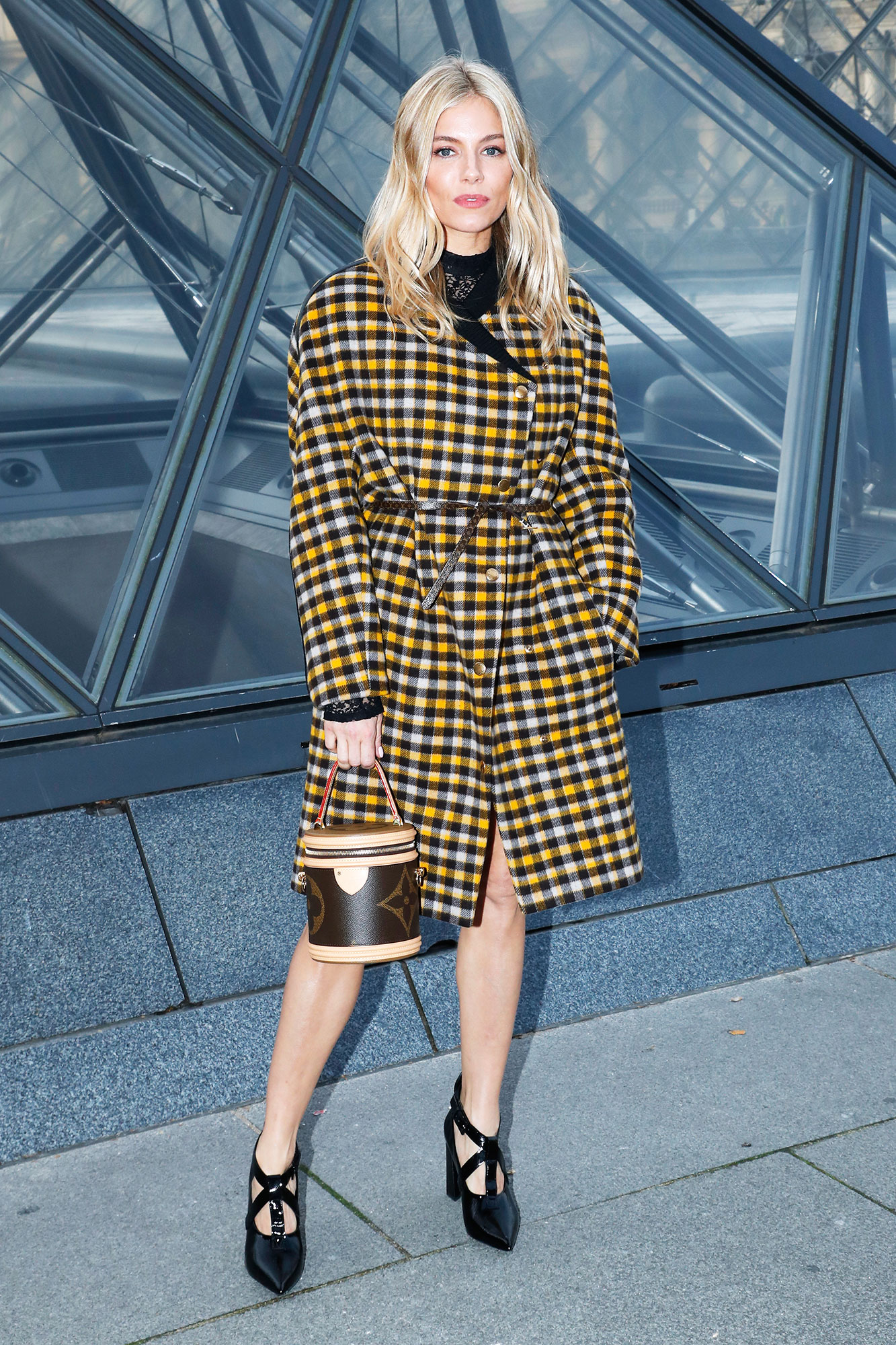 Sienna Miller Stars Closed Out Paris Fashion Week on a Sartorial High Note - We love how the blonde beauty belted her preppy plaid coat outside Louis Vuitton on Tuesday, March 5.