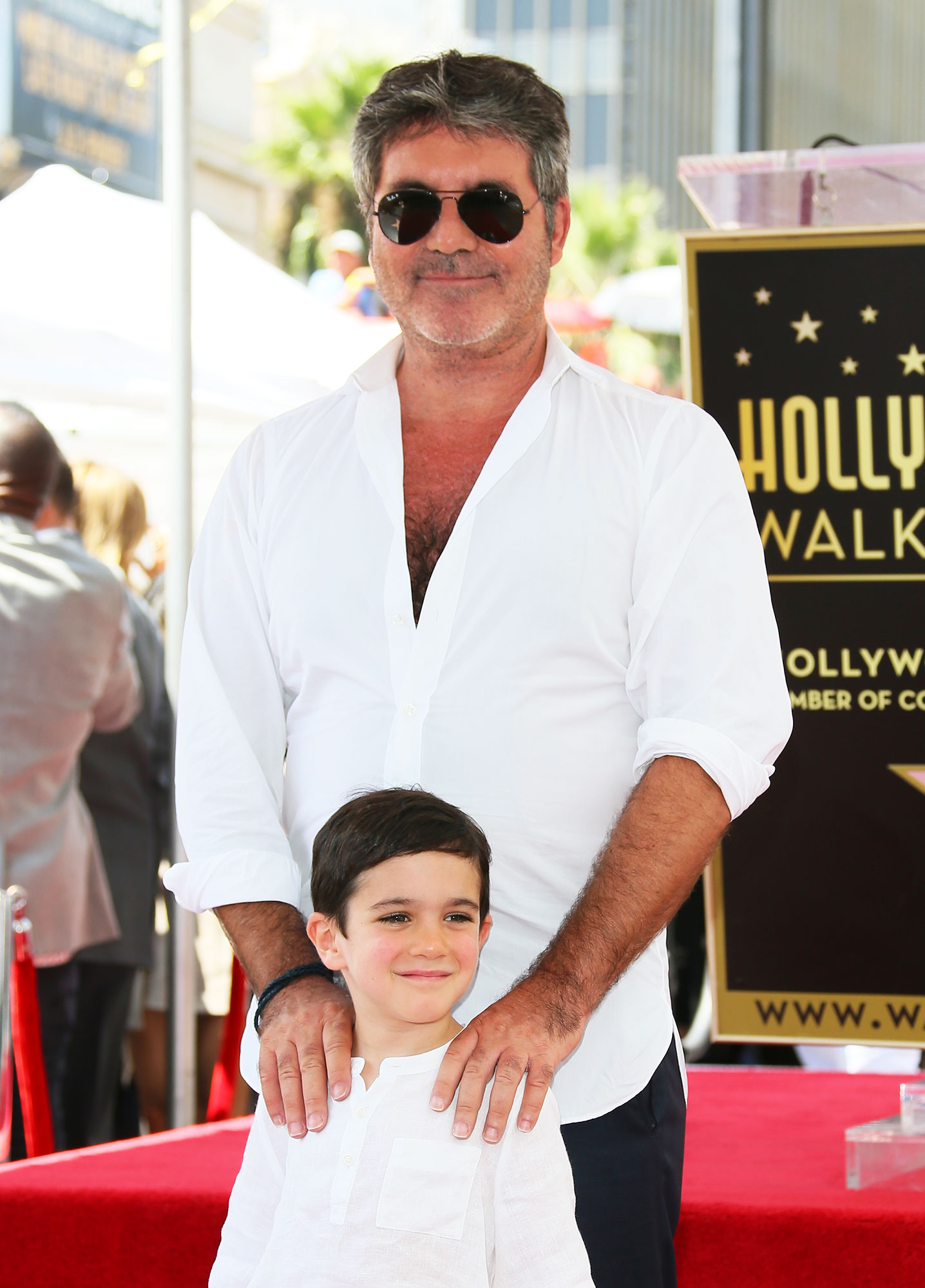 simon cowell's son doesn't know he's famous - Simon Cowell and Eric Cowell attend the ceremony honoring Simon Cowell with a Star on The Hollywood Walk of Fame held on August 22, 2018 in Hollywood, California.