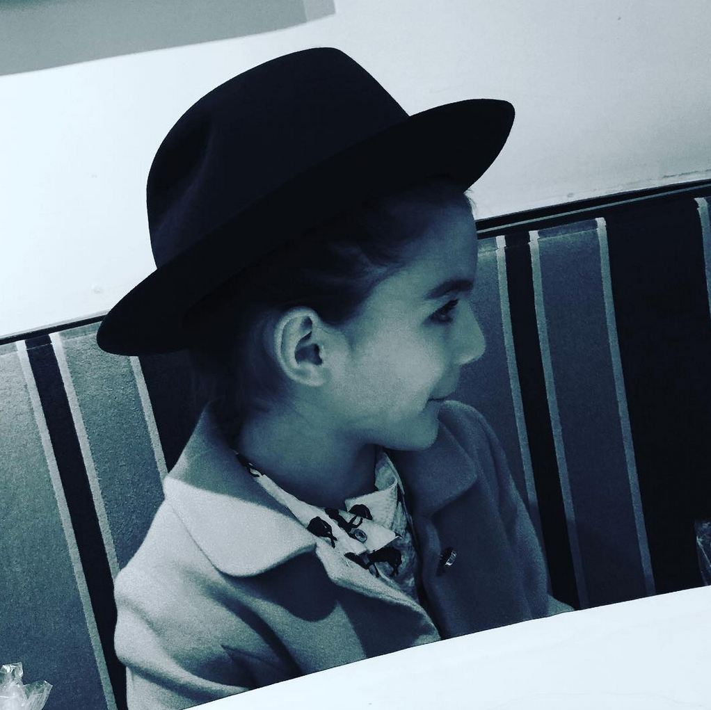 "suri-cruise-Mini-Fashion-Plate - Suri showed off her chic fashion sense and designer duds in an Instagram snap for Zac Posen 's birthday. ""Hat by Posen,"" Holmes wrote."
