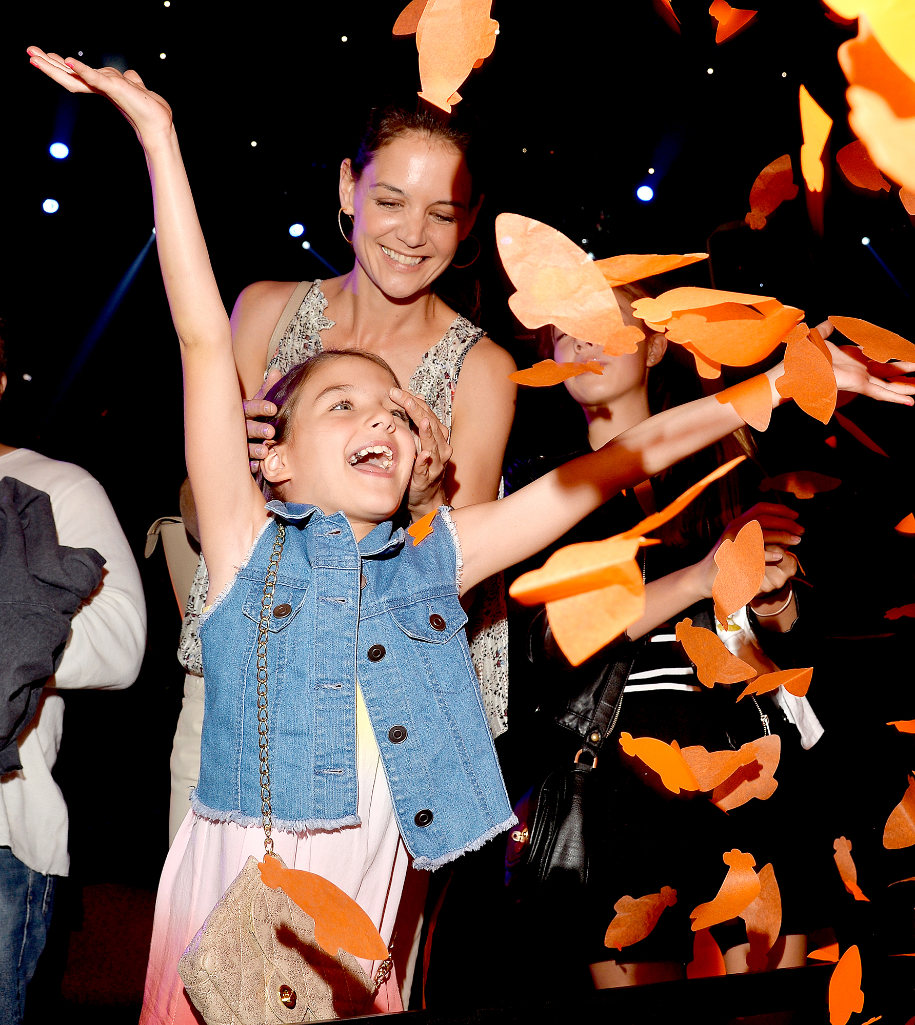 suri-cruise-birthday - INGLEWOOD, CA – MARCH 28: Suri Cruise (L) and actress Katie Holmes in the audience during Nickelodeon's 28th Annual Kids' Choice Awards held at The Forum on March 28, 2015 in Inglewood, California. (Photo by Lester Cohen/KCA2015/WireImage)