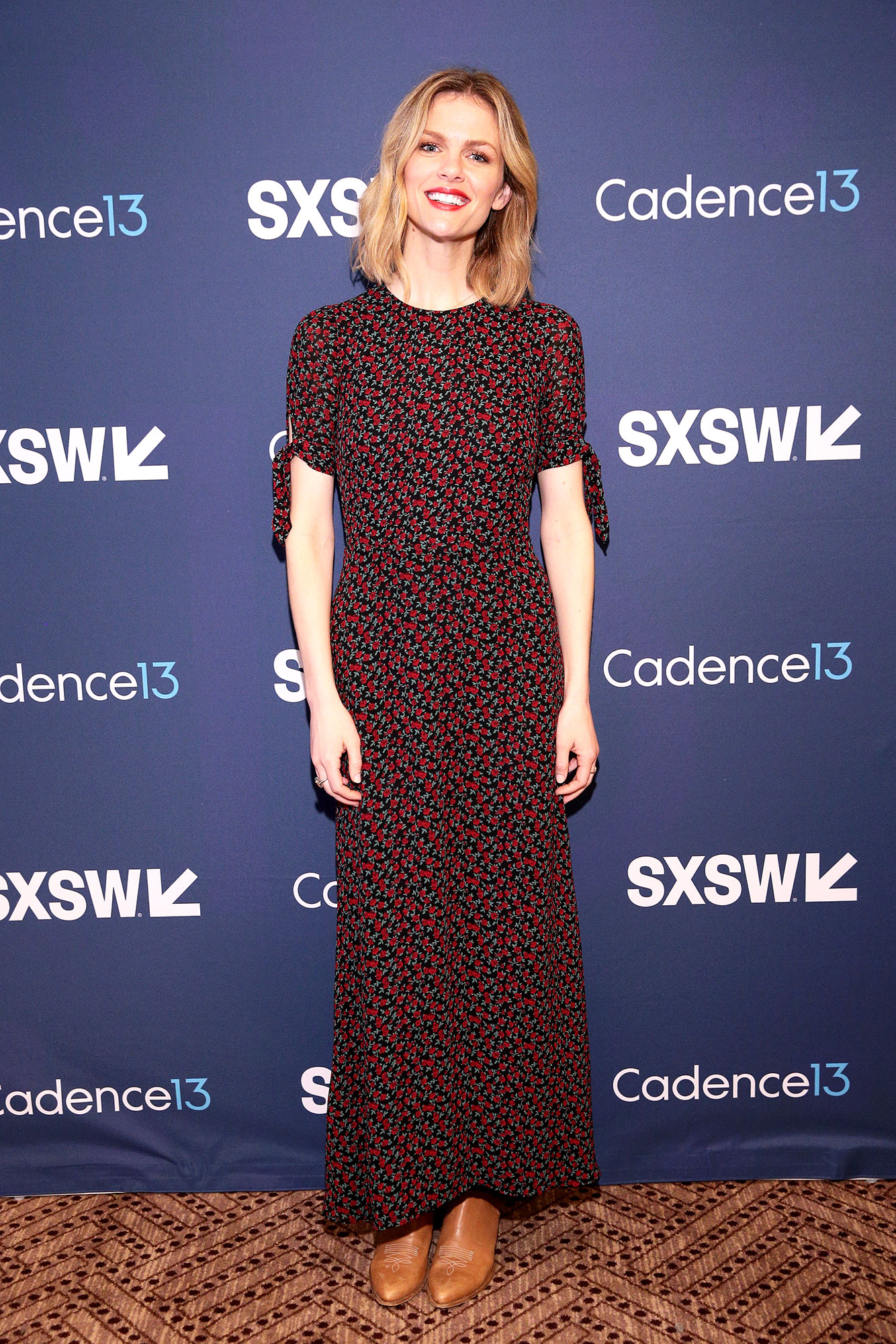 The Stars Bring Their Beauty and Style A-Game to SXSW - Delivering a masterclass in transitional dressing, the model paired her flower-printed frock with cute boots on Friday, March 8.
