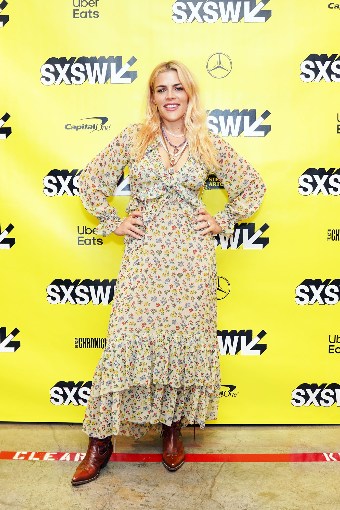 Busy Philipps The Stars Bring Their Beauty and Style A-Game to SXSW - The best way to accessorize a pretty floral maxi? With cowboy boots and piled-on necklaces as the late-night host did on Friday, March 8.