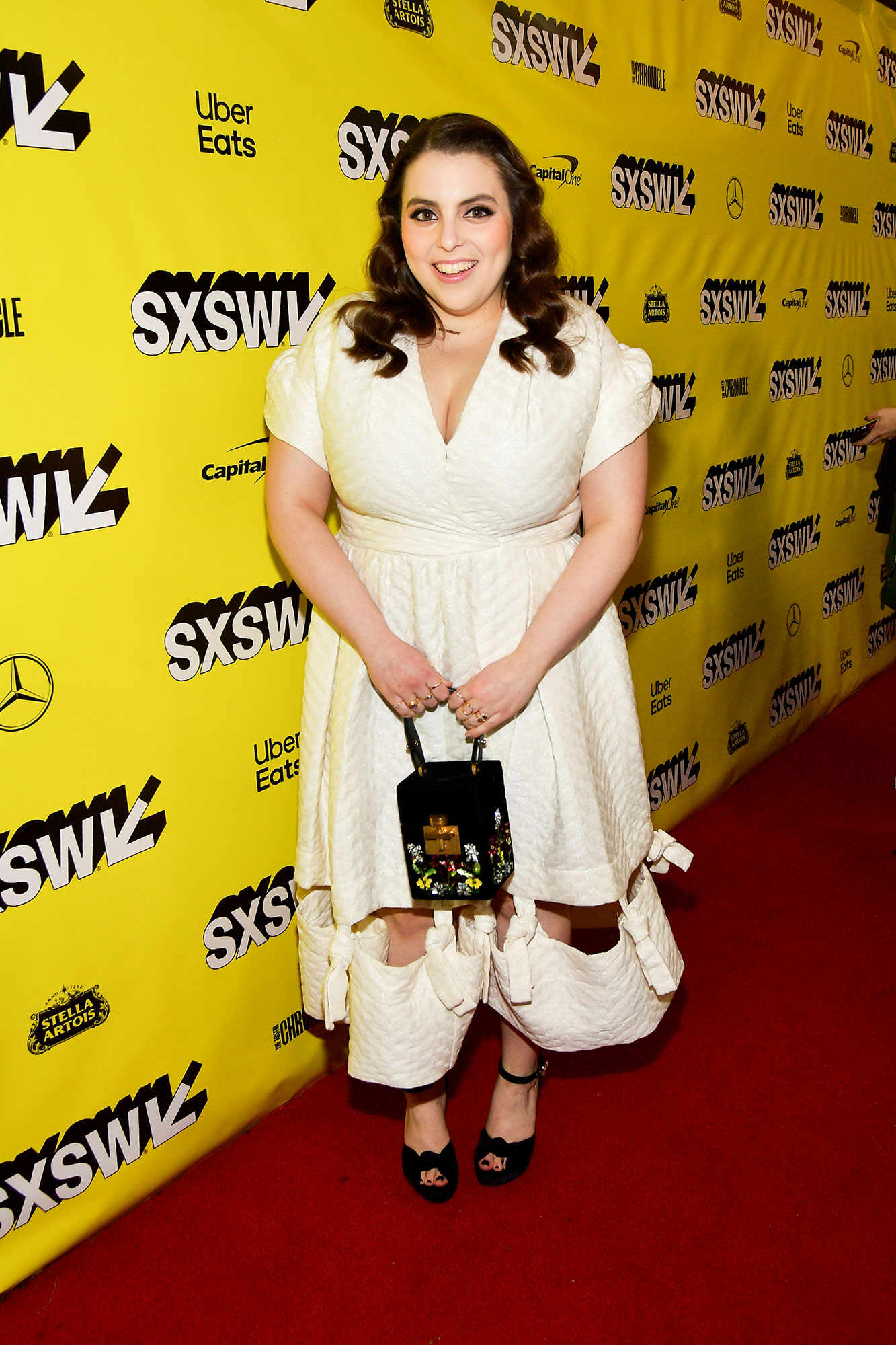 Beanie Feldstein The Stars Bring Their Beauty and Style A-Game to SXSW - A cutout hem added some edge to the actress' ivory midi at the Booksmart screening on Sunday, March 10.