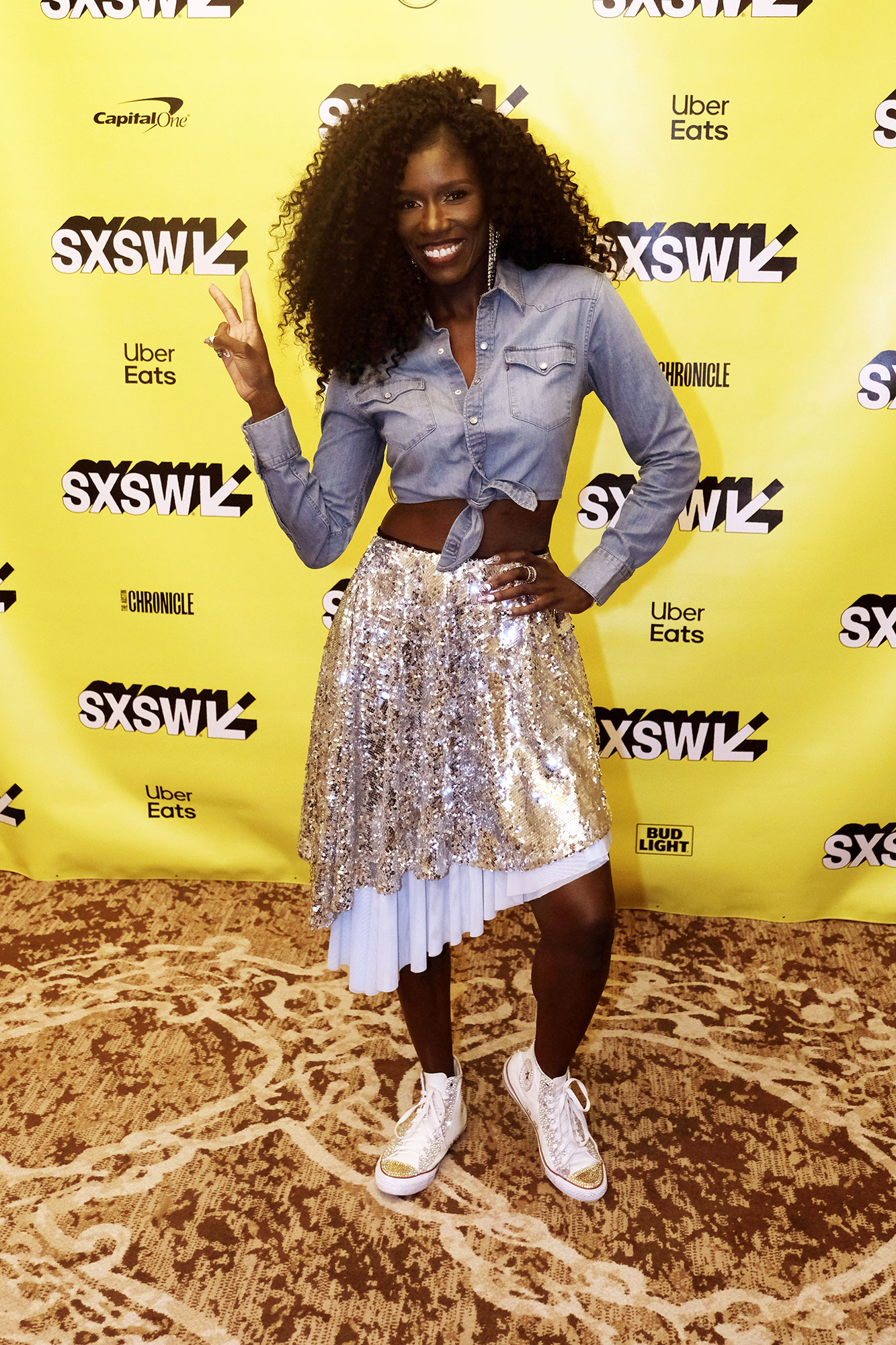 Bozoma Saint John Stars Were All About the Crop Top at Day 6 of SXSW - Showing Us all how to rock a bit of sparkle for day, the boss lady paired an ab-baring chambray shirt and high tops with her sequined skirt on Wednesday, March 13.