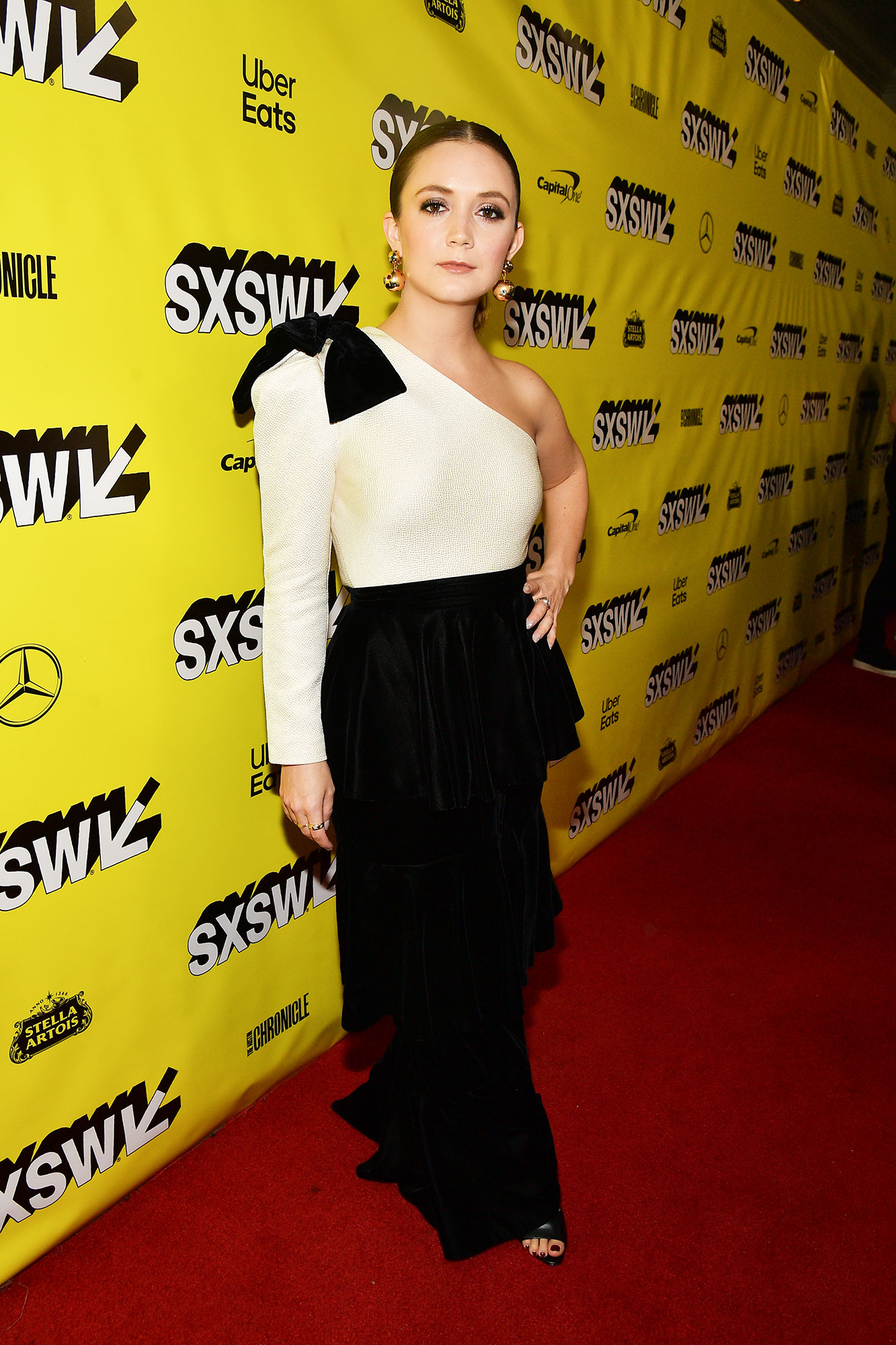 The Stars Bring Their Beauty and Style A-Game to SXSW - It was all about the '80s vibes for the actress in a one-shoulder black and white gown at the Booksmart premiere on Sunday, March 10.
