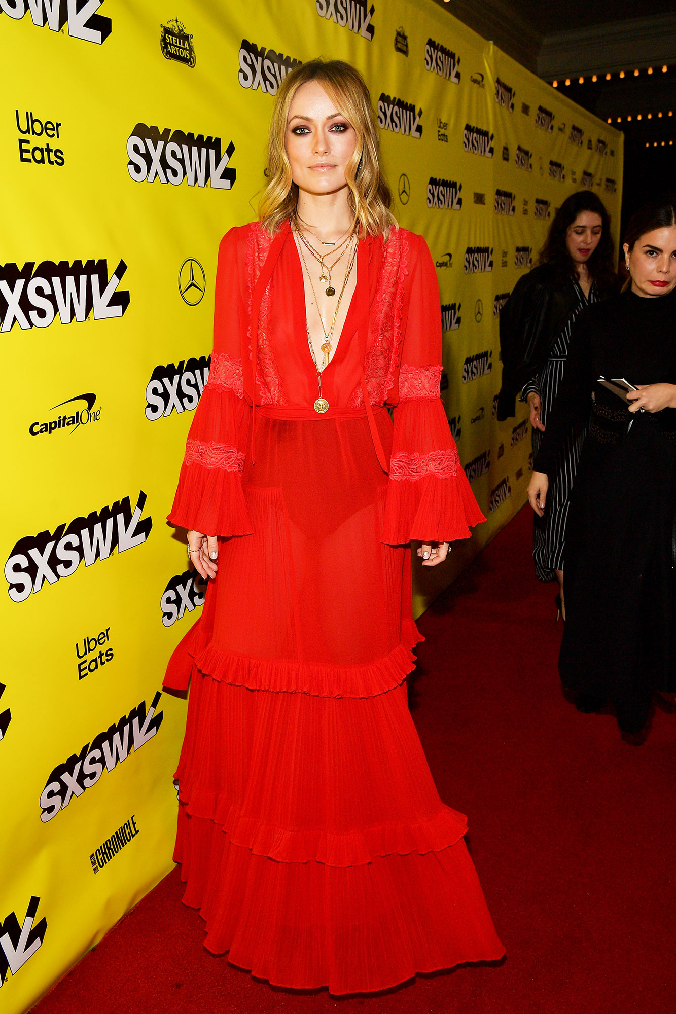 The Stars Bring Their Beauty and Style A-Game to SXSW - Red hot! The Booksmart director showed off her sexy boho style in a flowing Dundas gown and layered chains at the film's premiere on Sunday, March 10.