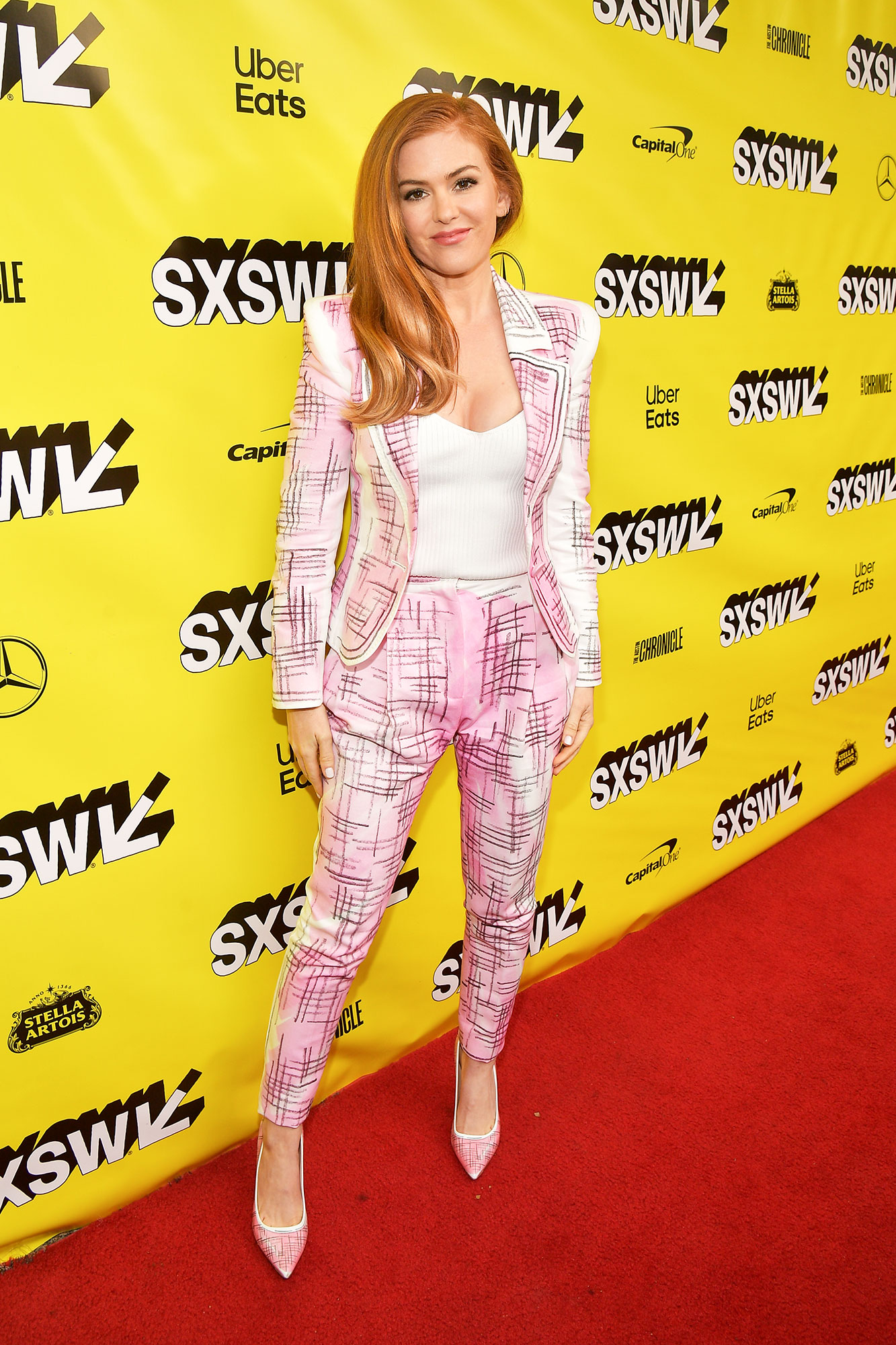 The Stars Bring Their Beauty and Style A-Game to SXSW - The star was pretty in pink at the Beach Bum screening on Saturday, March 9, in her printed Moschino suit.