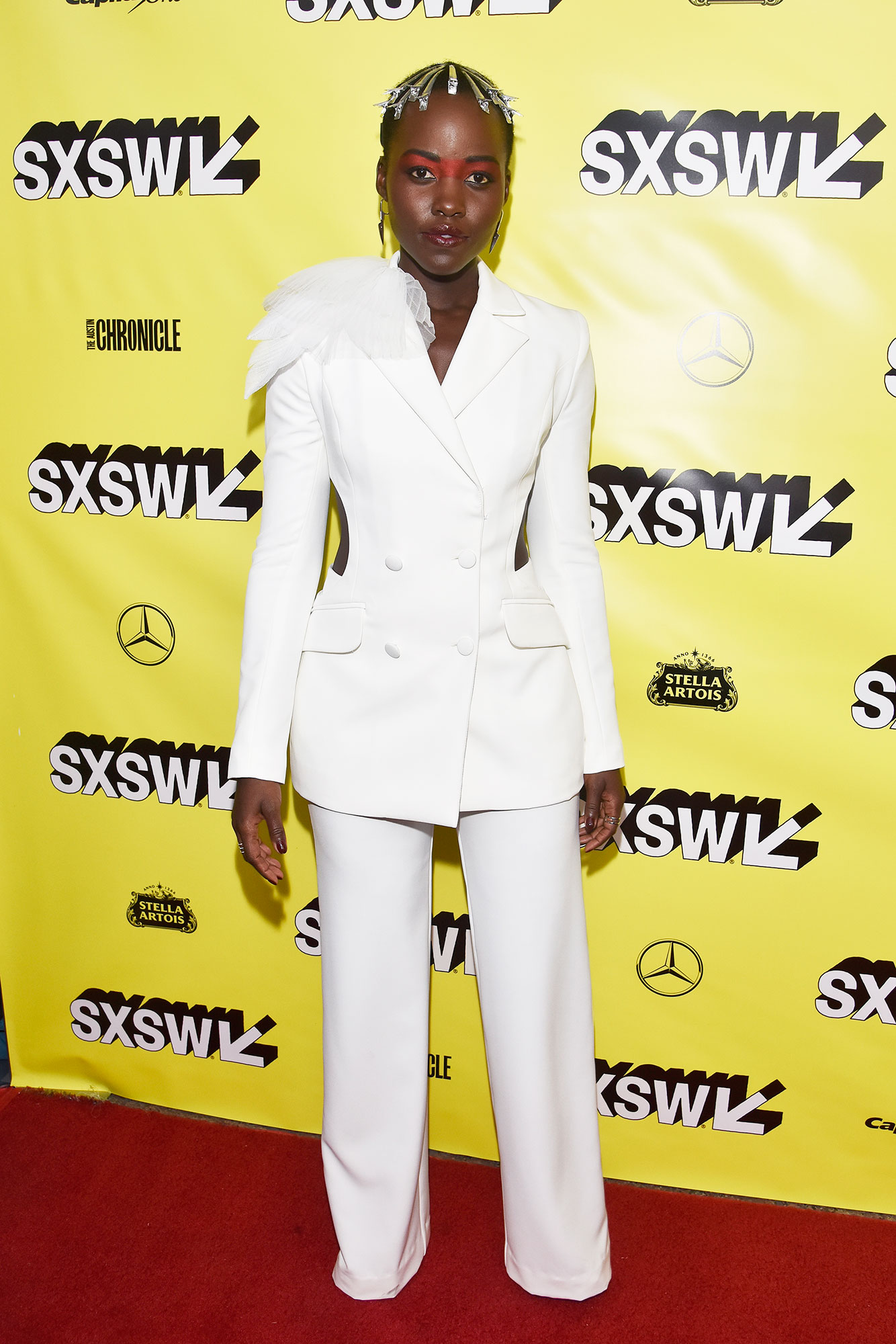 """The Stars Bring Their Beauty and Style A-Game to SXSW - Lupita Nyong'o attends the world premiere of """"US"""" during the 2019 SXSW Conference and Festival at the Paramount Theater on March 08, 2019 in Austin, Texas."""