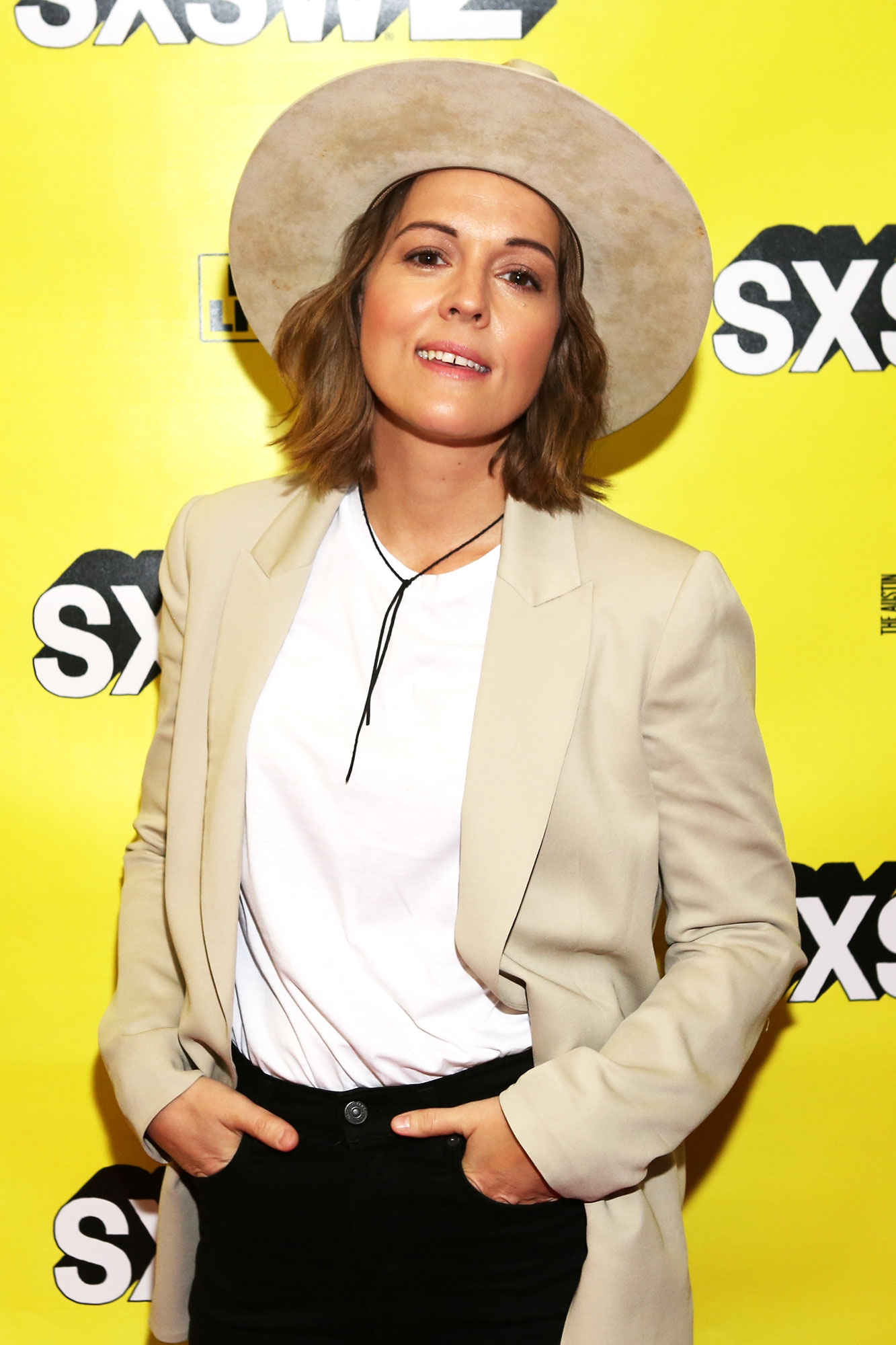 The Stars Bring Their Beauty and Style A-Game to SXSW - The songstress made the case for matching your blazer to her headwear at an interview on Sunday, March 10.