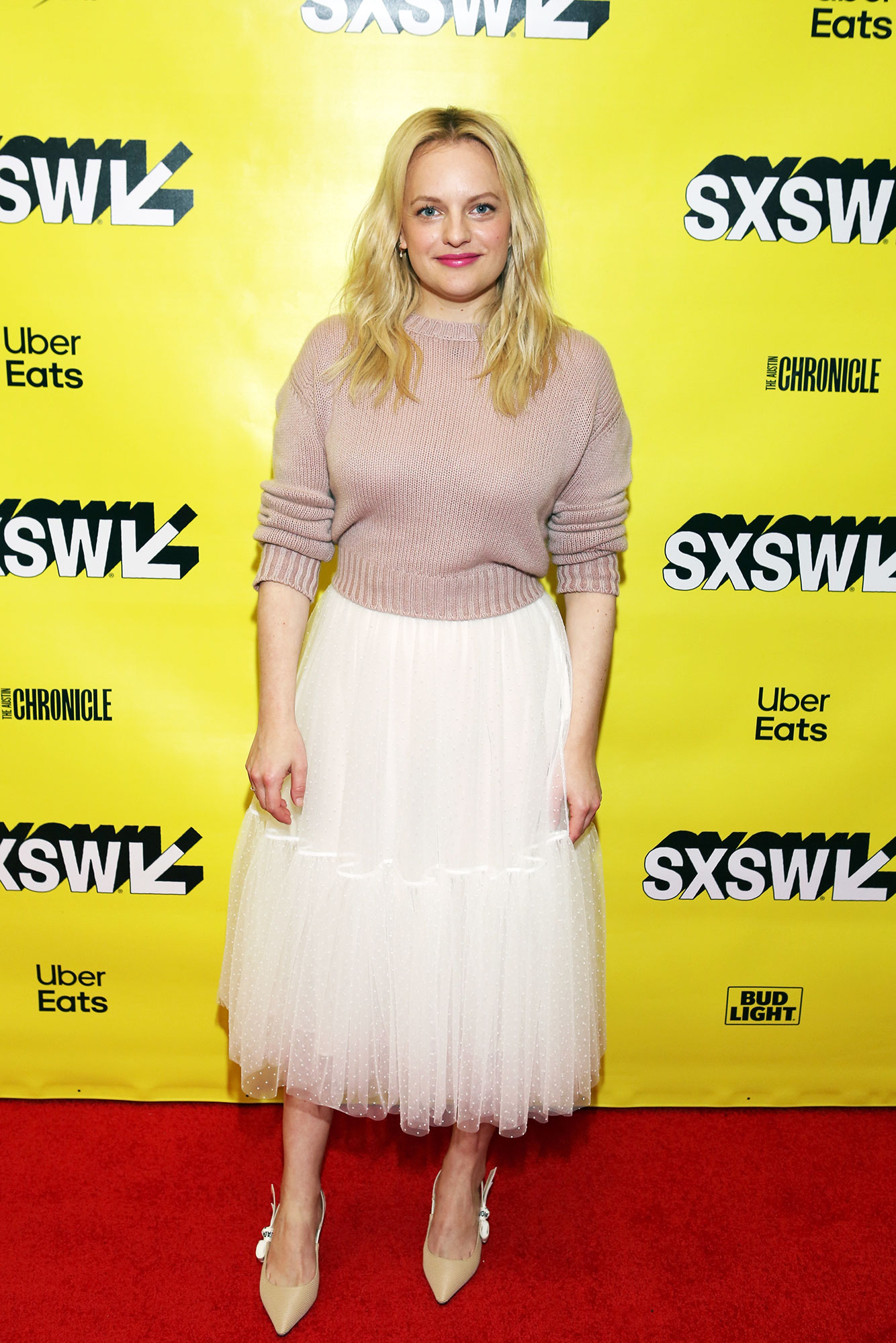 The Stars Bring Their Beauty and Style A-Game to SXSW - The Handmaid's Tale star gave her frilly Dior skirt and kitten heel combo a casual spin thanks to a chunky cropped sweater on Sunday, March 10.