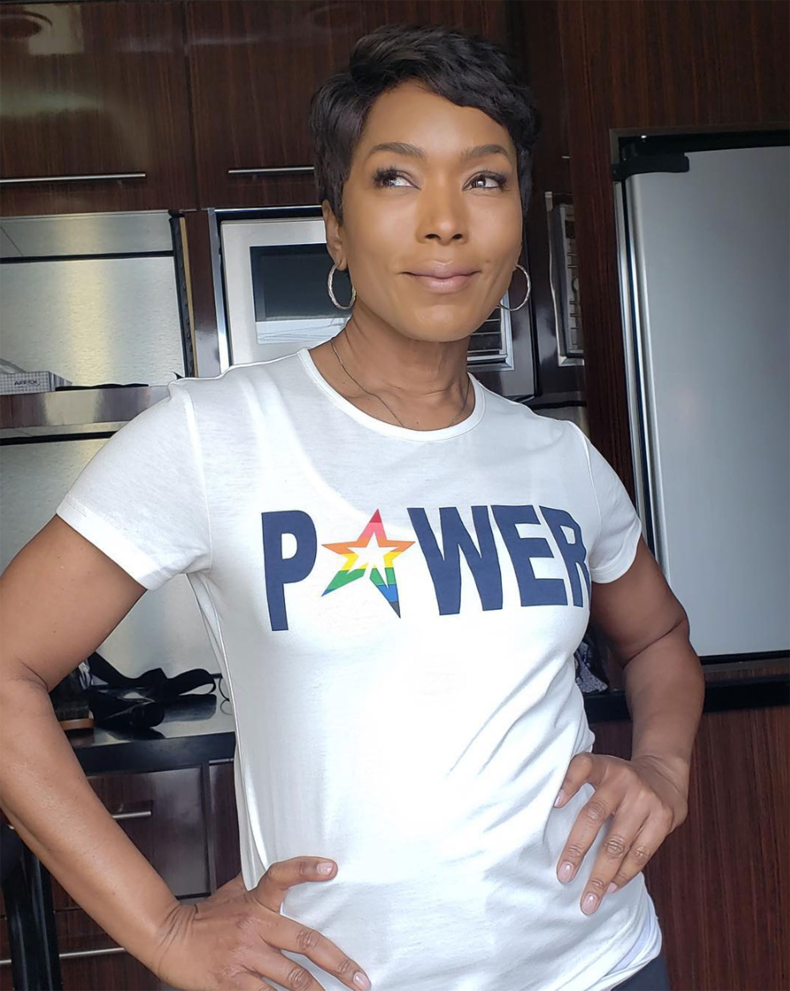 Angela Bassett Net-a-Porter Is Here With a Star-Studded T-Shirt Collection for International Women's Day - Showing off her power (and fierce pixie!), the actress rocked the bold tee by Perfect Moment. $170, net-a-porter.com