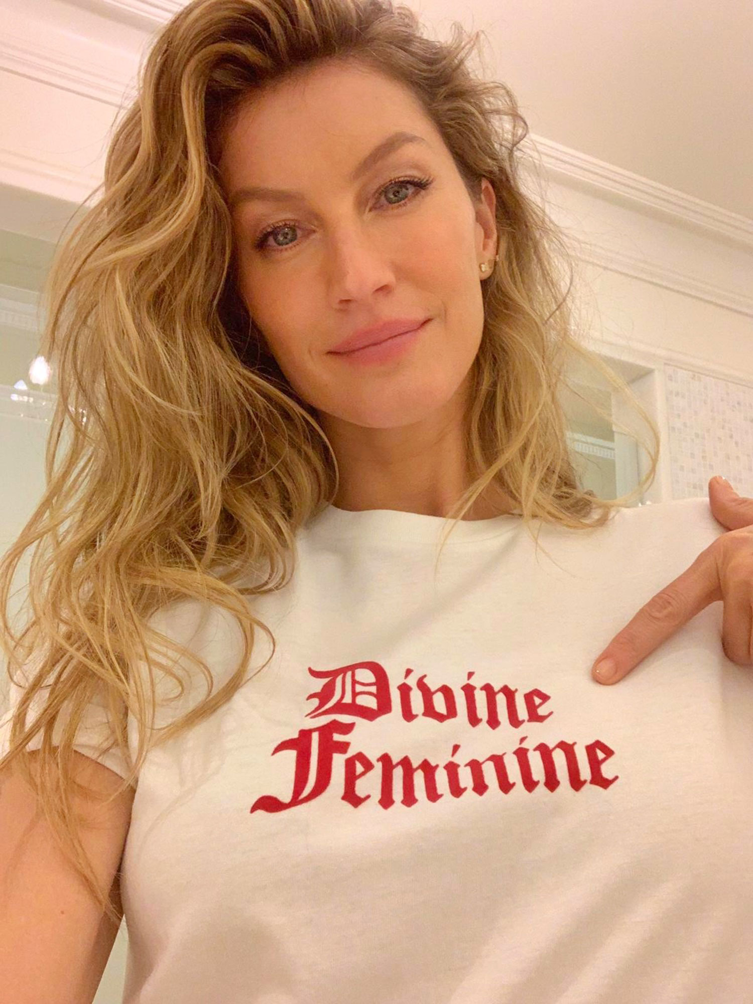 "Net-a-Porter Is Here With a Star-Studded T-Shirt Collection for International Women's Day - The model snapped a selfie wearing Alexa Chung's ""Divine Feminine"" design. $130, net-a-porter.com"