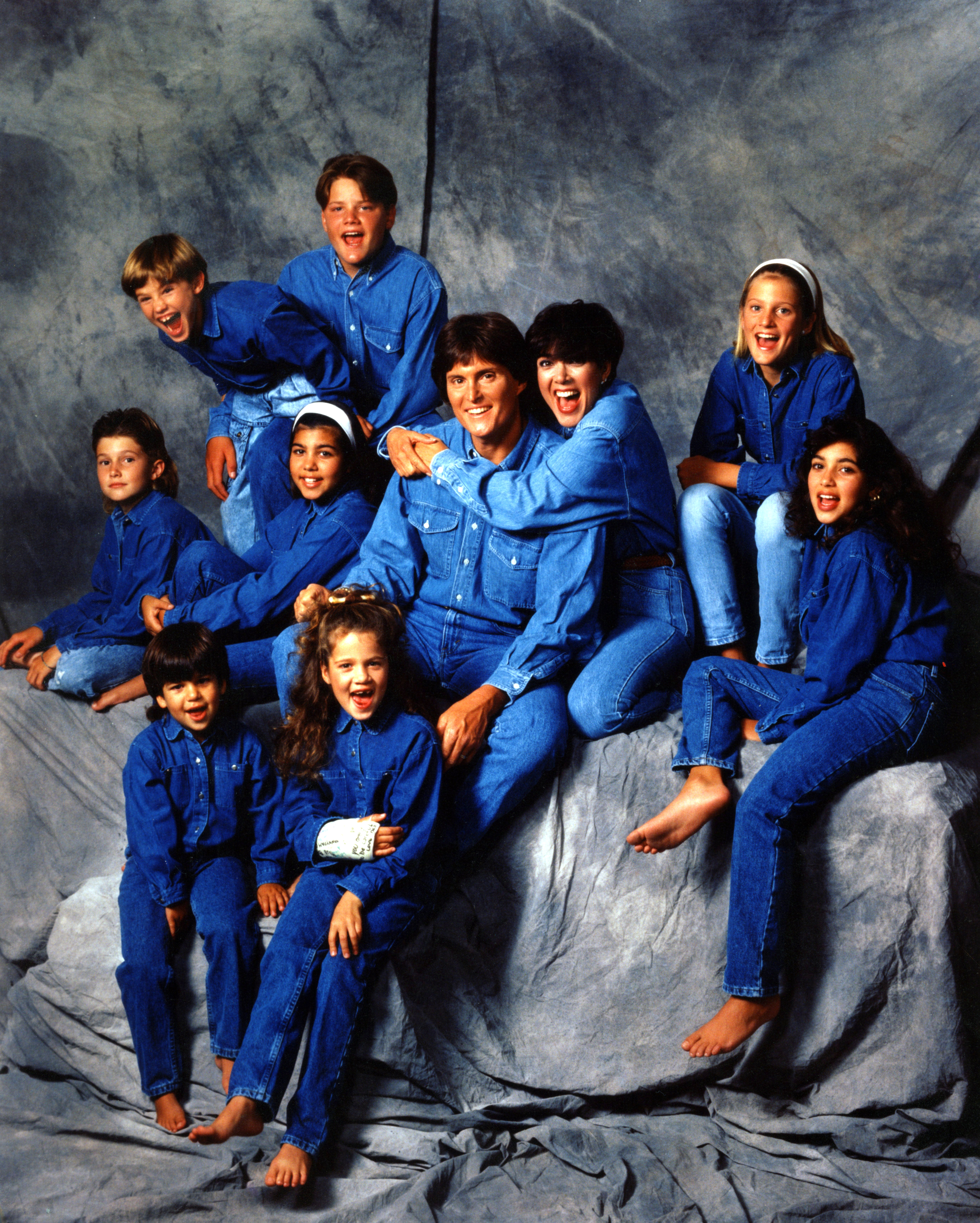 Kourtney Kardashian Through the Years - The Kardashian-Jenners love a family portrait! Kourtney posed in all-denim with Kim, Khloé and Rob and step-siblings Brody, Cassandra, Brandon and Burt Jenner in 1991.