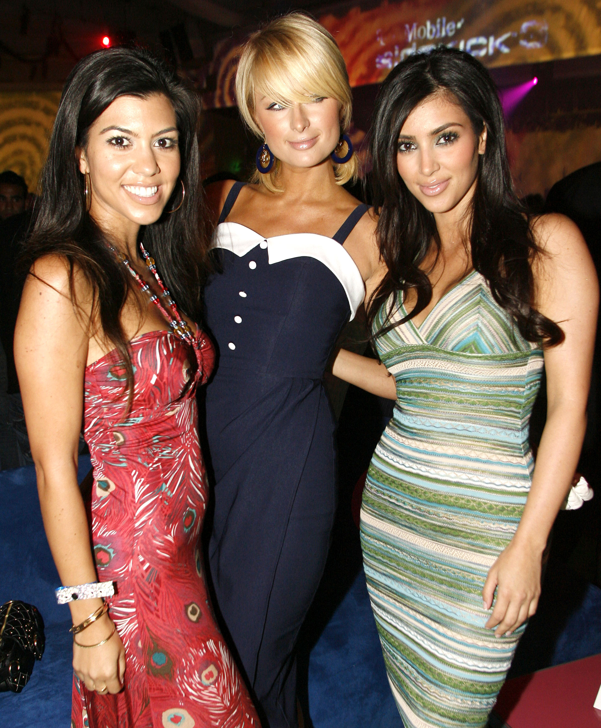 Kourtney Kardashian Through the Years - Kourtney and Kim often partied with Paris Hilton, whom the KKW Beauty CEO worked for, in 2006.