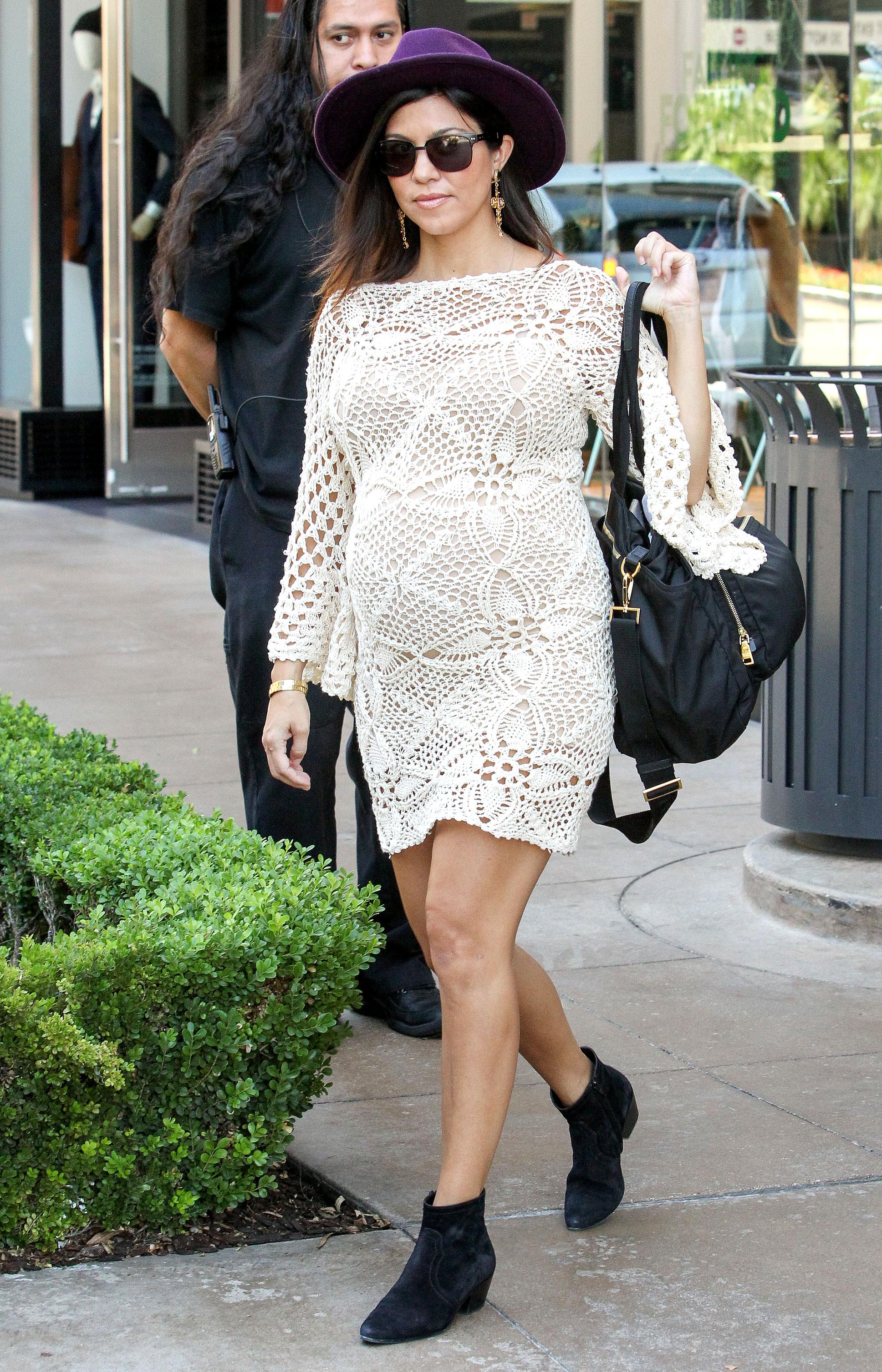 Kourtney Kardashian Through the Years - Us broke the news 2014 that Kourtney was pregnant for a third time.