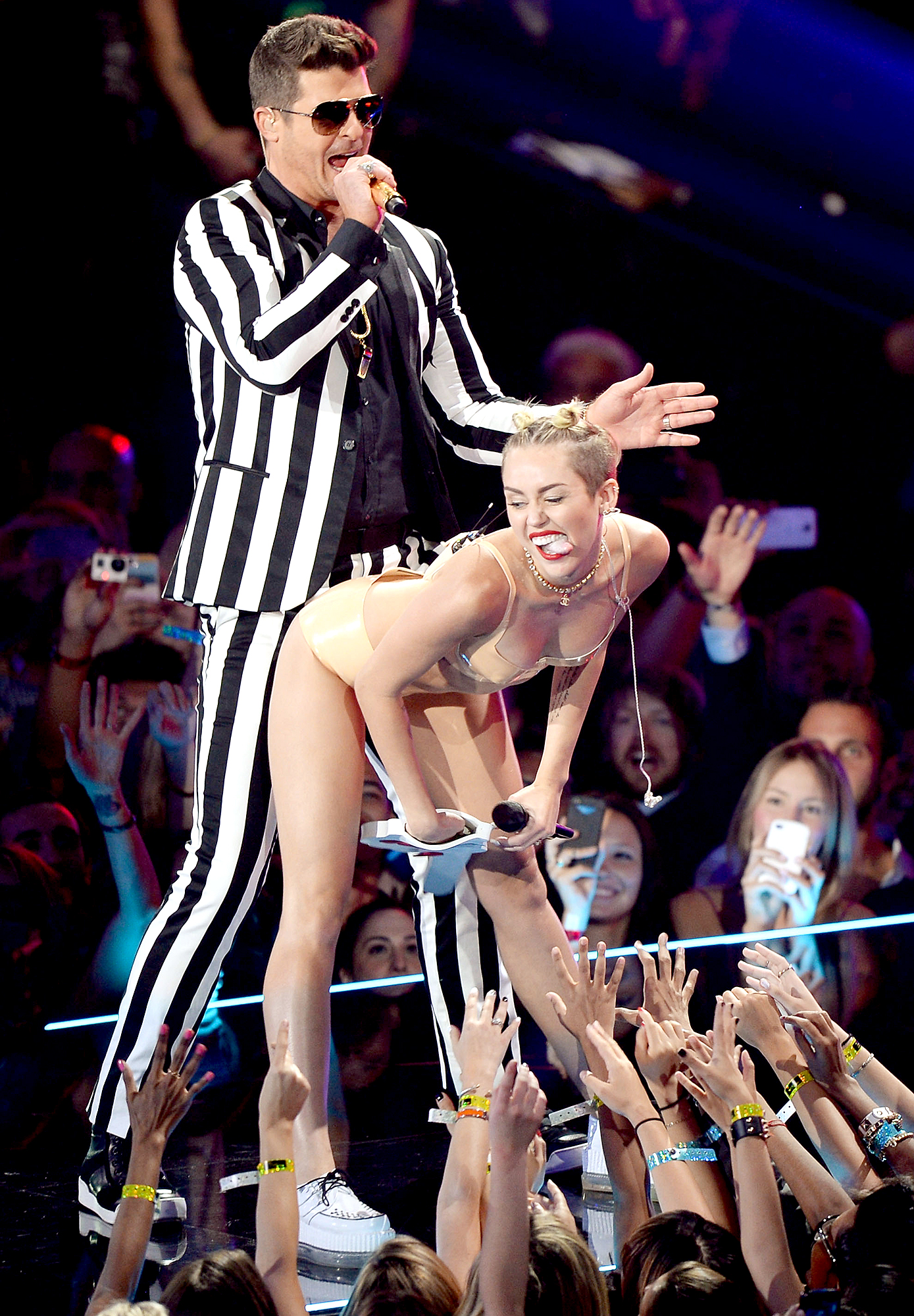 """miley-cyrus-robin-thicke - The Last Song actress made waves during her 2013 VMAs performance — in which she infamously twerked on Robin Thicke — and she had a perfectly good explanation for her antics. """" I was an adult when I was supposed to be a kid ,"""" she said in the October 2013 issue of Harper's Bazaar ."""