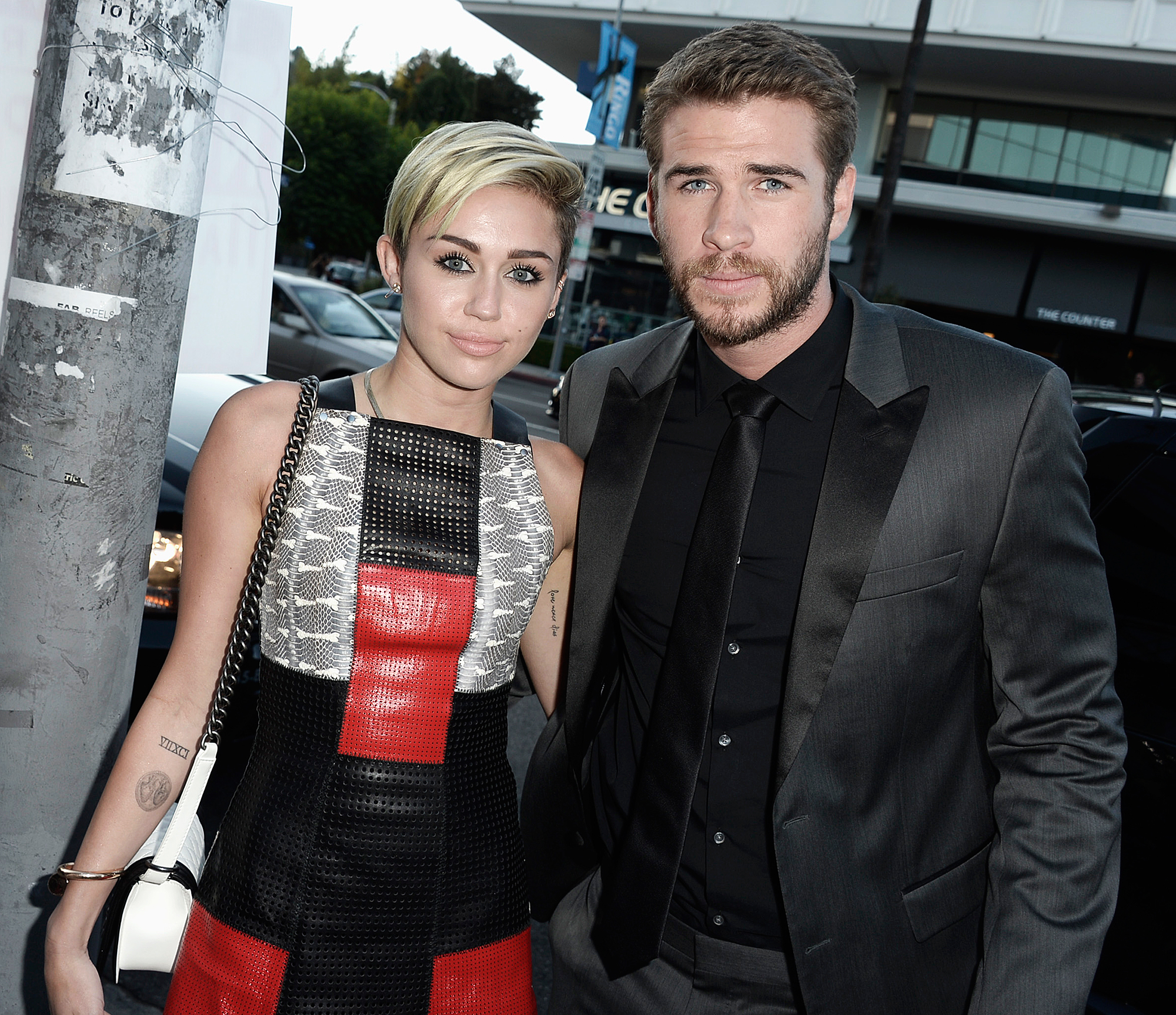 """miley-cyrus-liam-hemsworth - In a sit-down interview with writer Tavi Gevinson for the May 2014 issue of ELLE , Cyrus opened up about feeling anxious when she was attached to the network that launched her to stardom, as well as when she was with now-husband Liam Hemsworth , from whom she split in 2013 before rekindling their romance . """"When I went through a really intense breakup — you know, I was engaged — and when I was with [Liam] or when I was on Disney, the thing that gave me the most anxiety was not knowing what to do with myself when Disney wasn't there to carry me anymore or if I didn't have him,"""" she said at the time."""
