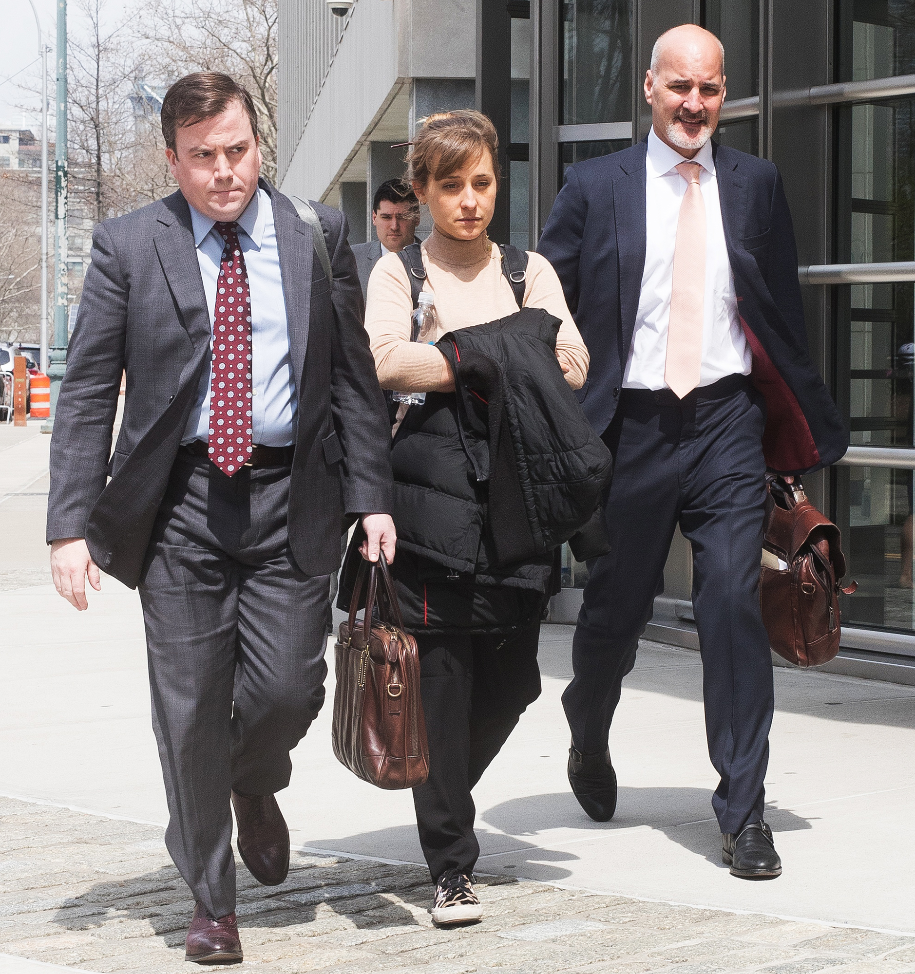 Allison-Mack-court - The Smallville alum changed her plea from not guilty to guilty on charges of racketeering and racketeering conspiracy in the NXIVM sex-trafficking case on April 8, 2019. The Germany native, who was arrested on charges of sex trafficking, sex-trafficking conspiracy and conspiracy to commit forced labor, faces a maximum of up to 40 years in prison.