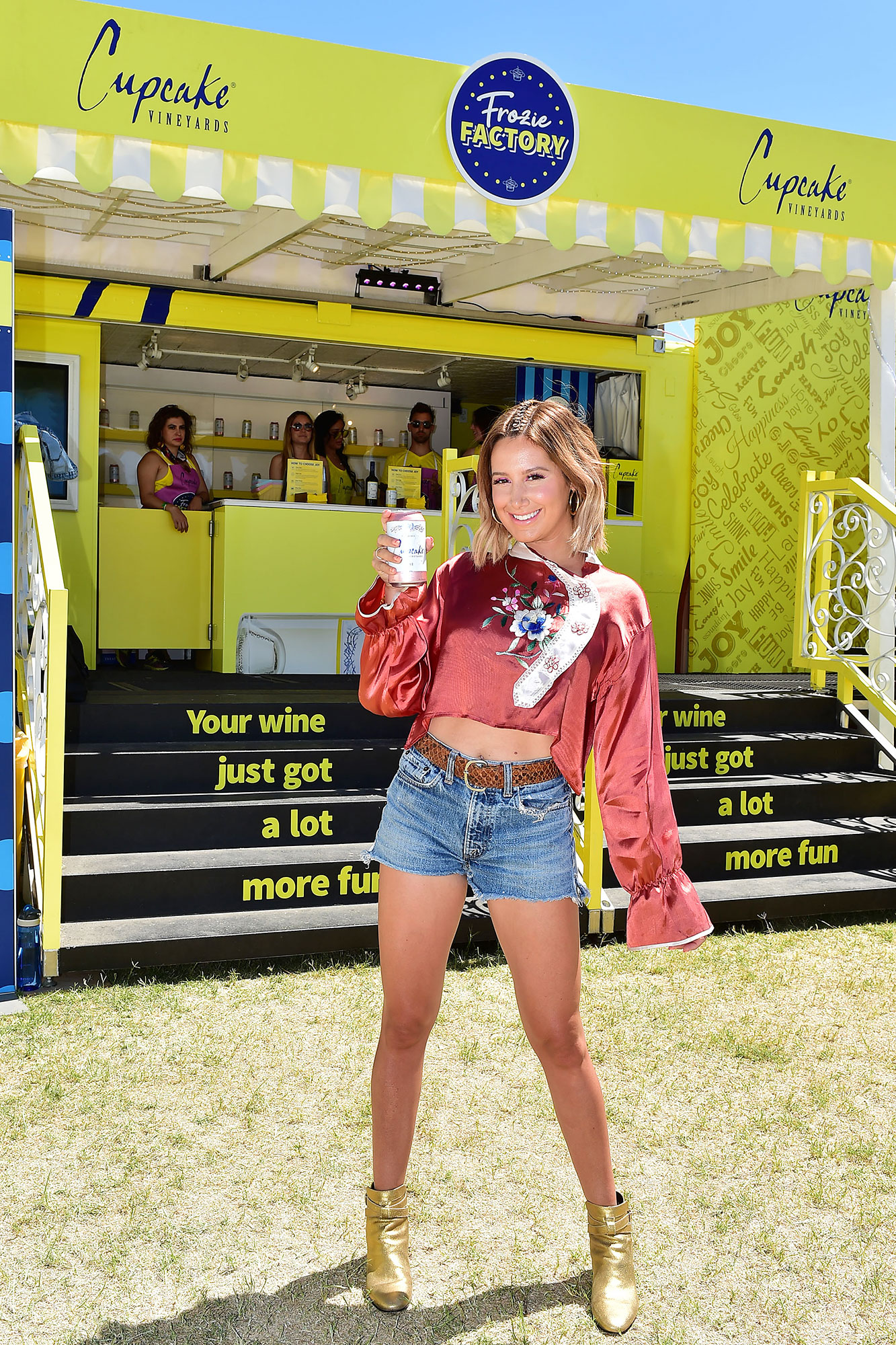 Ashley Tisdale Cupcake Rose Coachella - The Scary Movie 5 alum kicked back with a can of Cupcake Rose at Coachella Music & Arts Festival on Saturday, April 13.