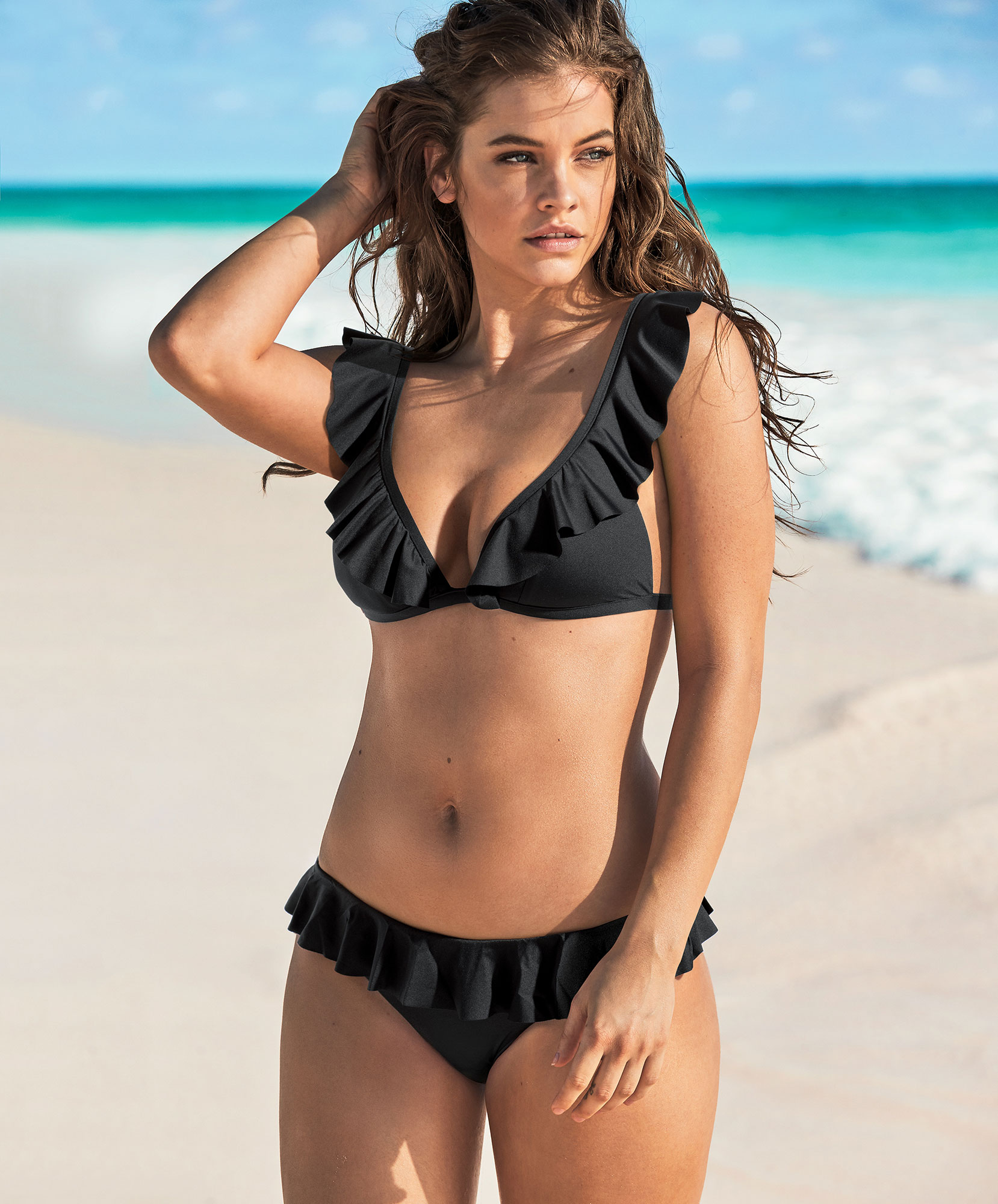 Barbara Palvin Calzedonia Swim beach - Dress up your go-to triangle top ($40, us.calzedonia.com ) and bikini bottom ($30, us.calzedonia.com ) with a some ruffles.