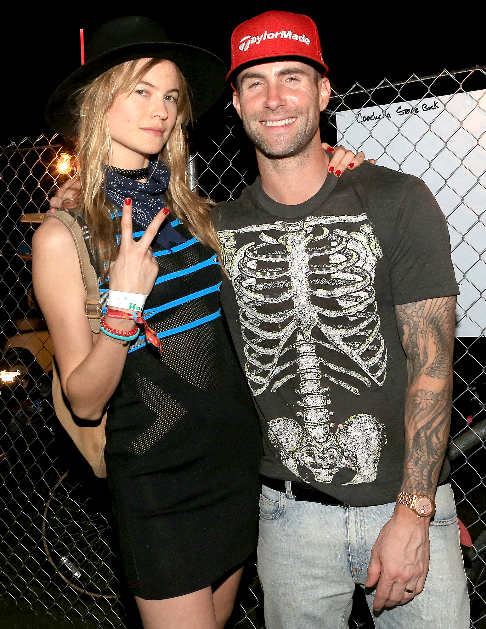 Behati-Prinsloo-Adam-levine-coachella - INDIO, CA – APRIL 10: Model Behati Prinsloo (L) and musician Adam Levine attend day 1 of the 2015 Coachella Valley Music & Arts Festival (Weekend 1) at the Empire Polo Club on April 10, 2015 in Indio, California. (Photo by Christopher Polk/Getty Images for Coachella)