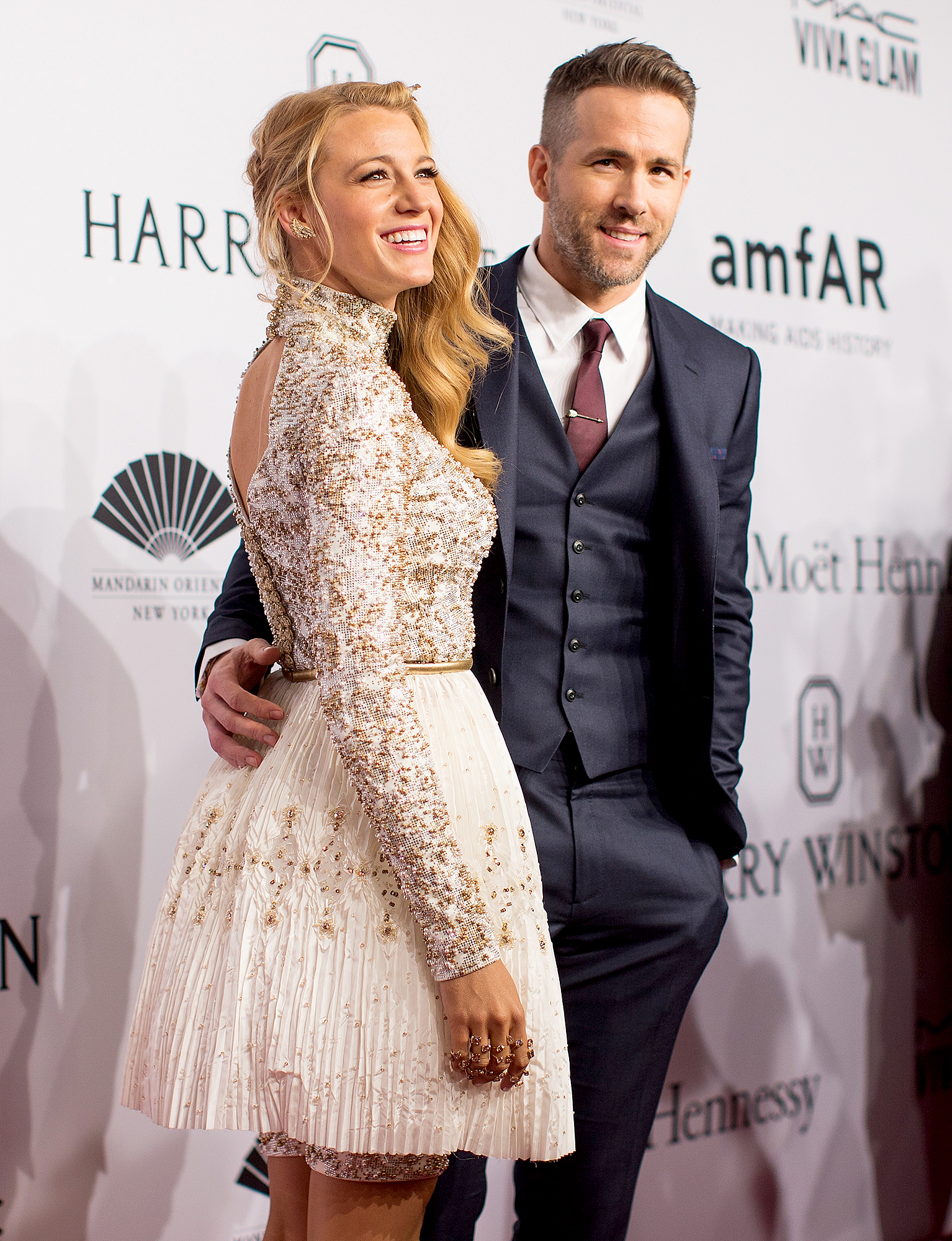 Blake-Lively-Ryan-Reynolds-April-2016 - NEW YORK, NY – FEBRUARY 10: Actors Blake Lively (L) and Ryan Reynolds attend the 2016 amfAR New York Gala at Cipriani Wall Street on February 10, 2016 in New York City. (Photo by Kevin Tachman/Getty Images)