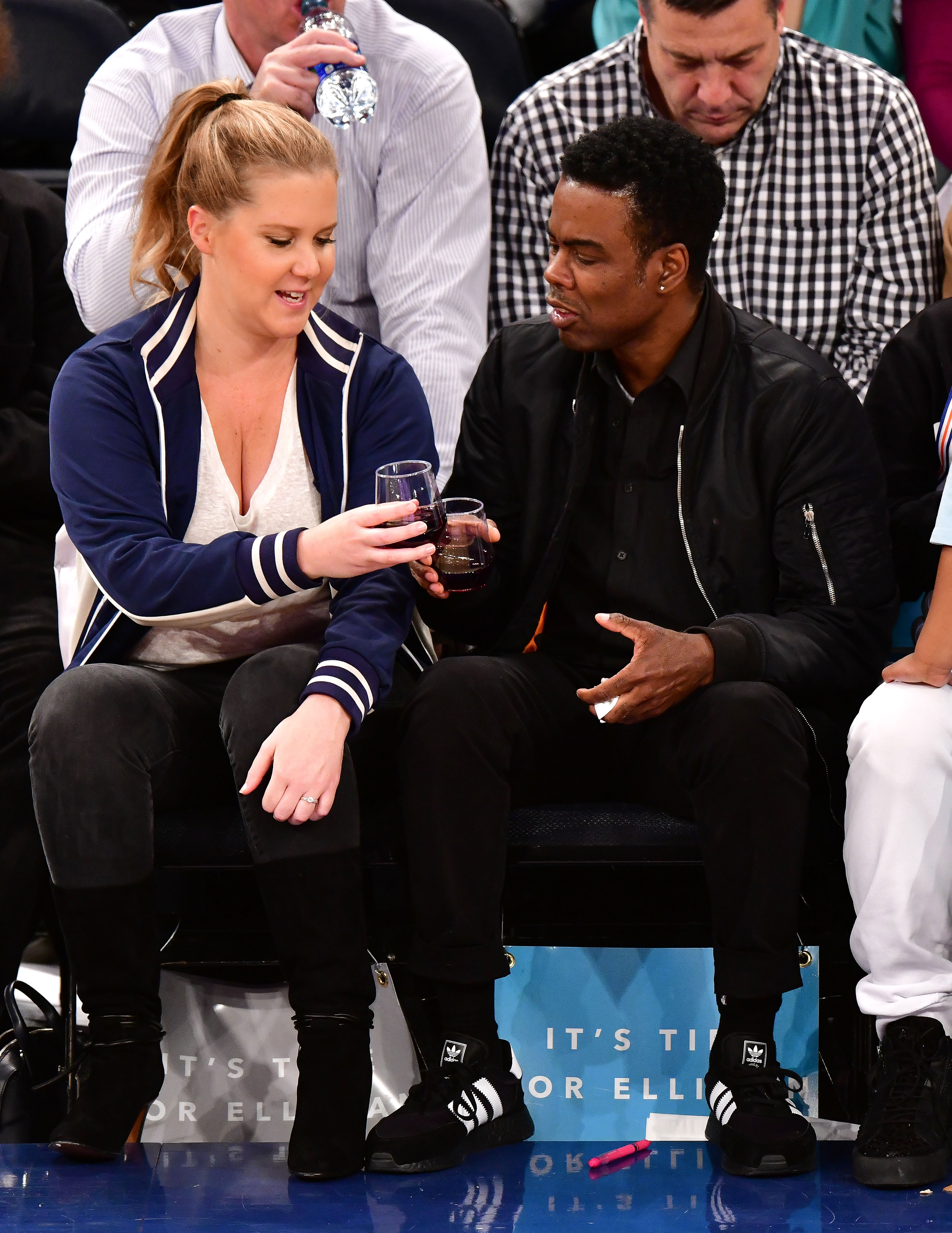 Celebs Eating Courtside - The stars toasted one another while watching the New York Knicks play the Golden State Warriors at Madison Square Garden in New York City on February 26, 2018.