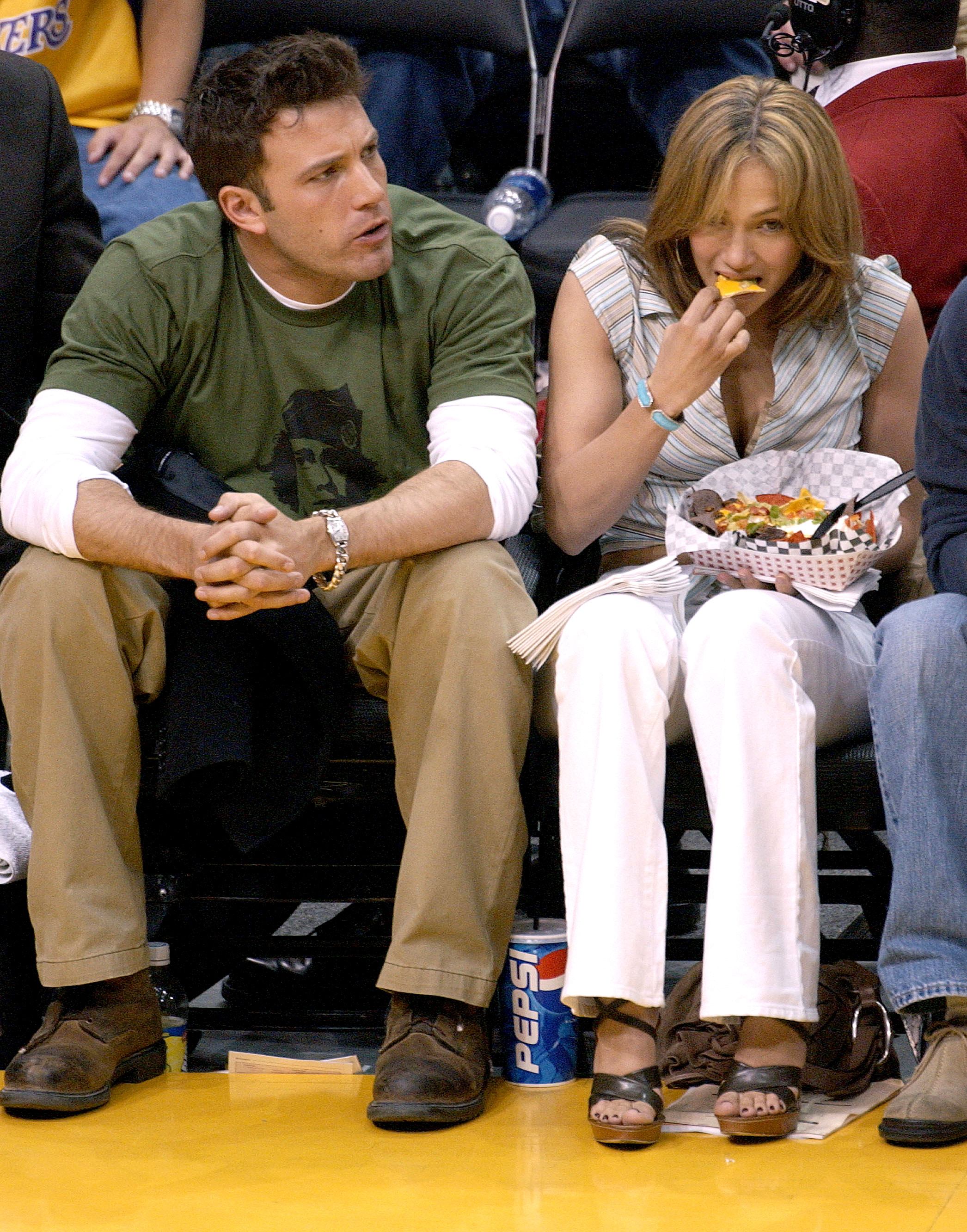 Celebs Eating Courtside - The formerly engaged costars have long since broken up, but before they split in 2004, they sat courtside to watch the Los Angeles Lakers take on the San Antonio Spurs in a playoff game at the Staples Center on May 11, 2003, in Los Angeles. While Affleck had his eyes on the game, Lopez was distracted by her nachos.