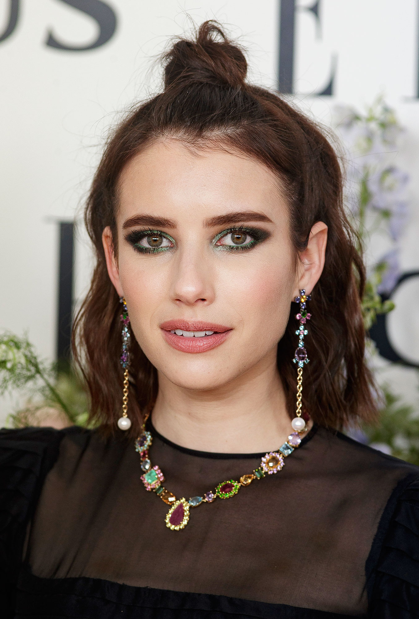 Emma Roberts' Half-Up Knot - The brunette beauty combined two trends in one with this wavy half-up, half-down topknot by mane woman Rebekah Forecast on Wednesday, April 3. Oh, and special shoutout to makeup artist Lisa Eldridge for that mesmerizing emerald eye.