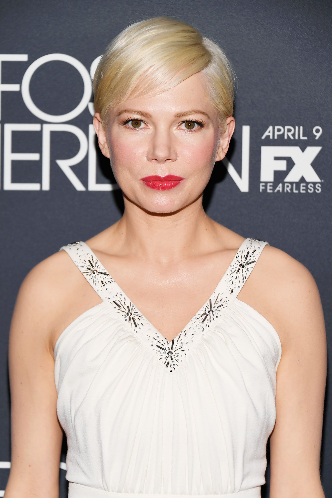 Michelle Williams' Peachy-Pink Pout - The actress' glossy coral lip at the Fosse/Verdon premiere on Monday, April 8, felt fresh and modern, and makeup artist Angela Levin used the new Dior Addict Stellar Shine lipstick in Positivity.