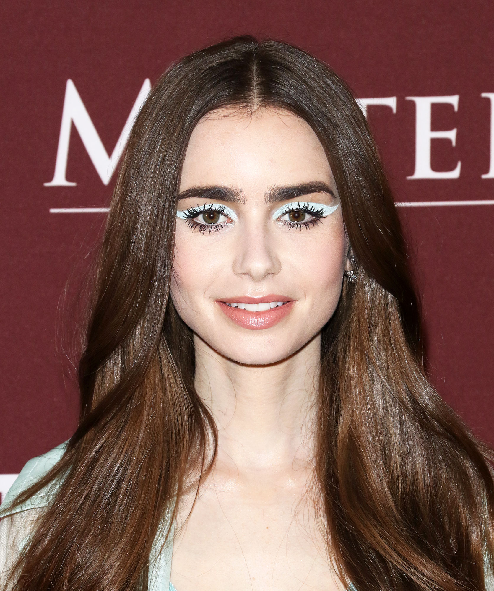 Lily Collins' Abstract Cat Eye - Having fun with color and proportion, makeup artist Vincent Oquendo created a graphic icy blue-winged look for the actress at the Les Miserables premiere on Monday, April 8. #ProTip: match your liner to your outfit for an unexpected take on spring's monochrome trend.
