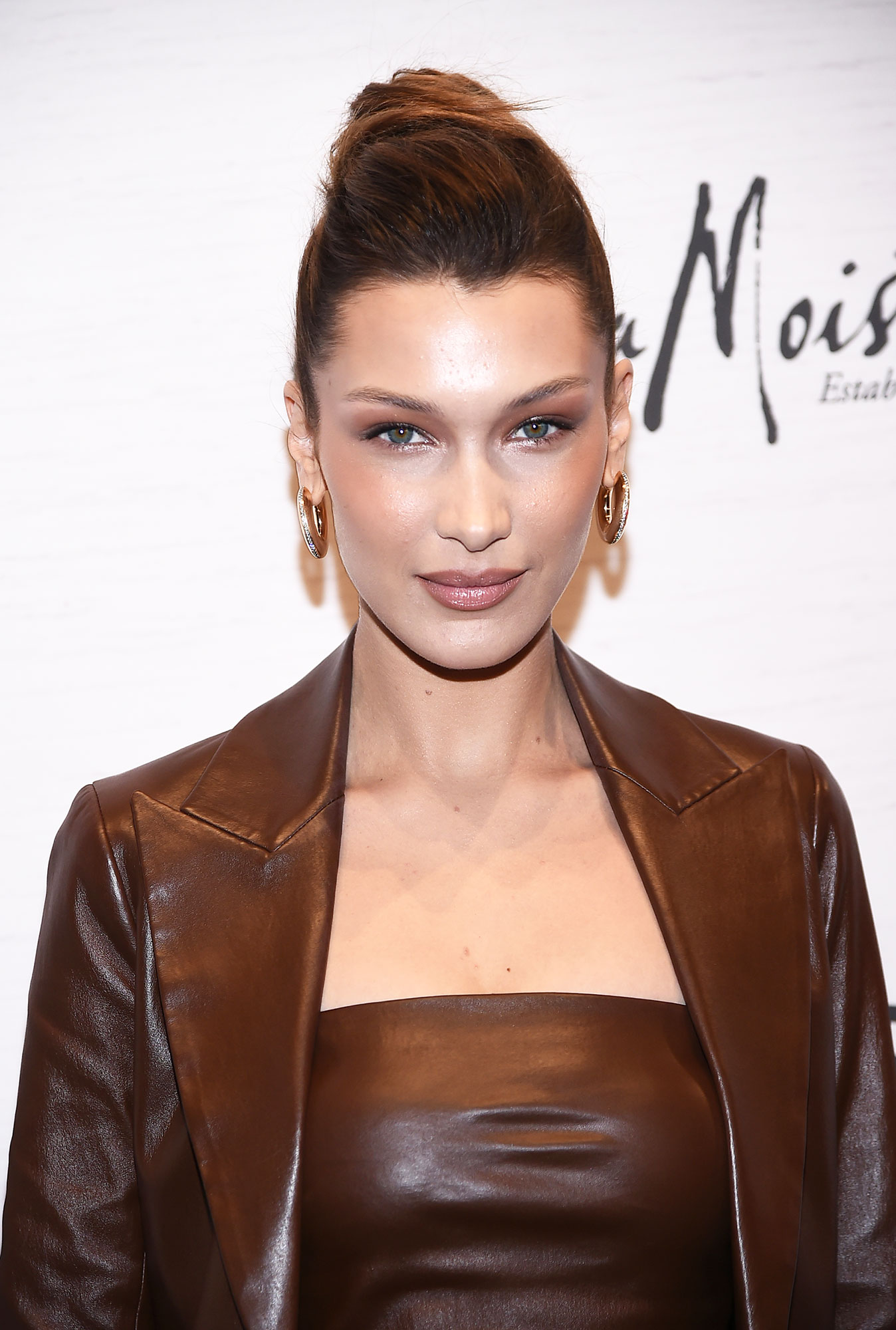 Bella Hadid's Undone Ballerina Bun - What better way to beat the desert heat than with a simply stylish top knot à la the model at the Variety's Power of Women luncheon on Friday, April 5? For an undone effect, celeb hairstylist Jennifer Yepez used the texturizing Playa New Day Mist and Soft Volume Powder.