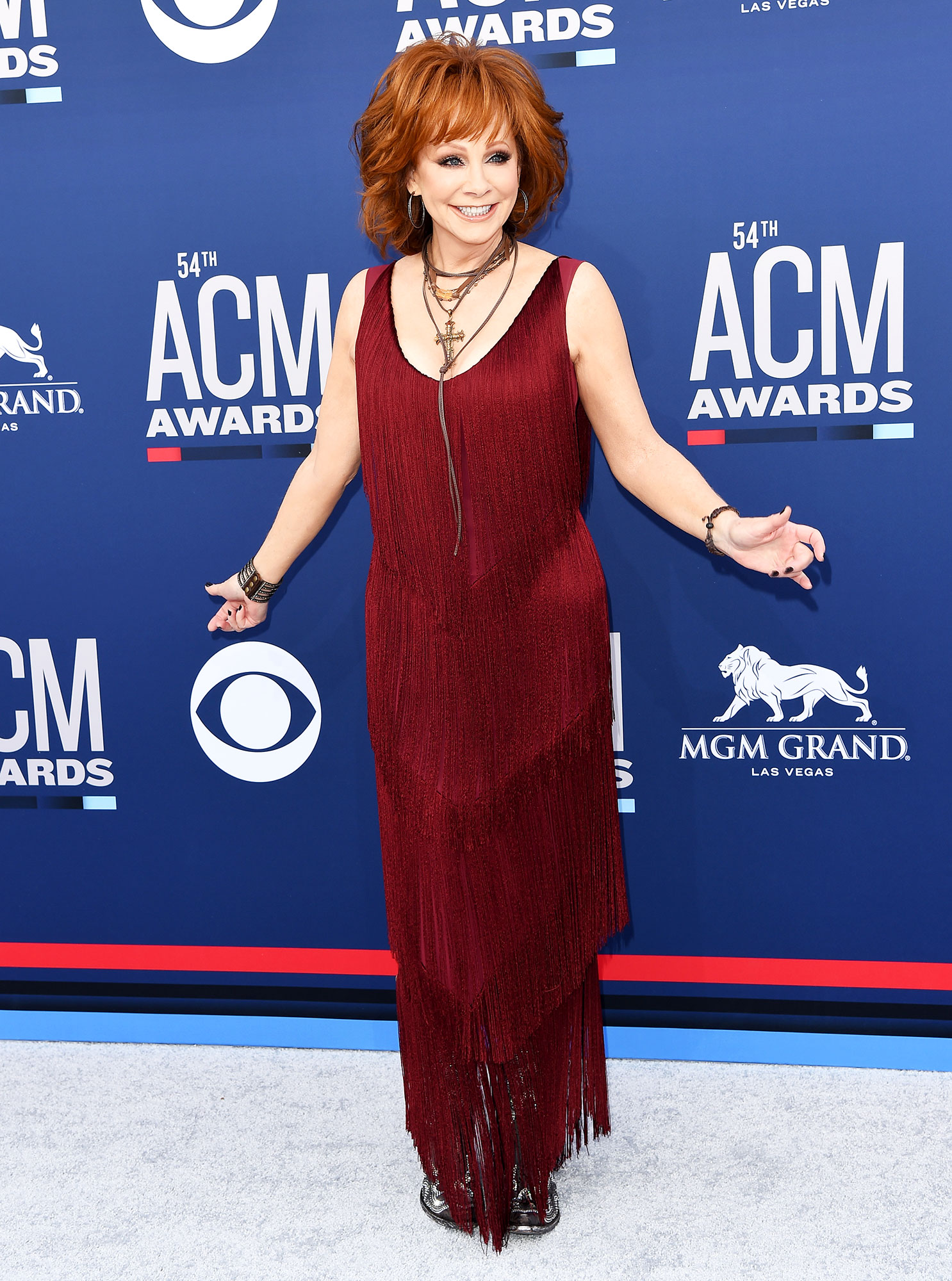 Reba McEntire The Best Looks From the Country Music Awards Red Carpet - The country music legend awed in a red fringe dress that was full of movement.