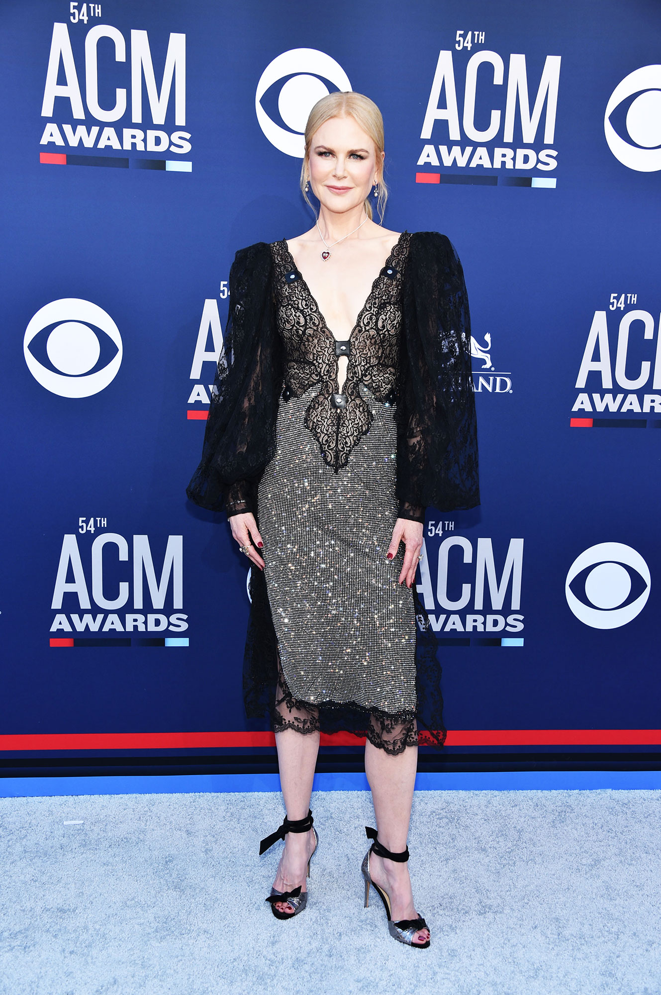 Nicole Kidman The Best Looks From the Country Music Awards Red Carpet - In a lacy look, the Big Little Lies actress proved herself a red carpet star in a black and silver mididress.