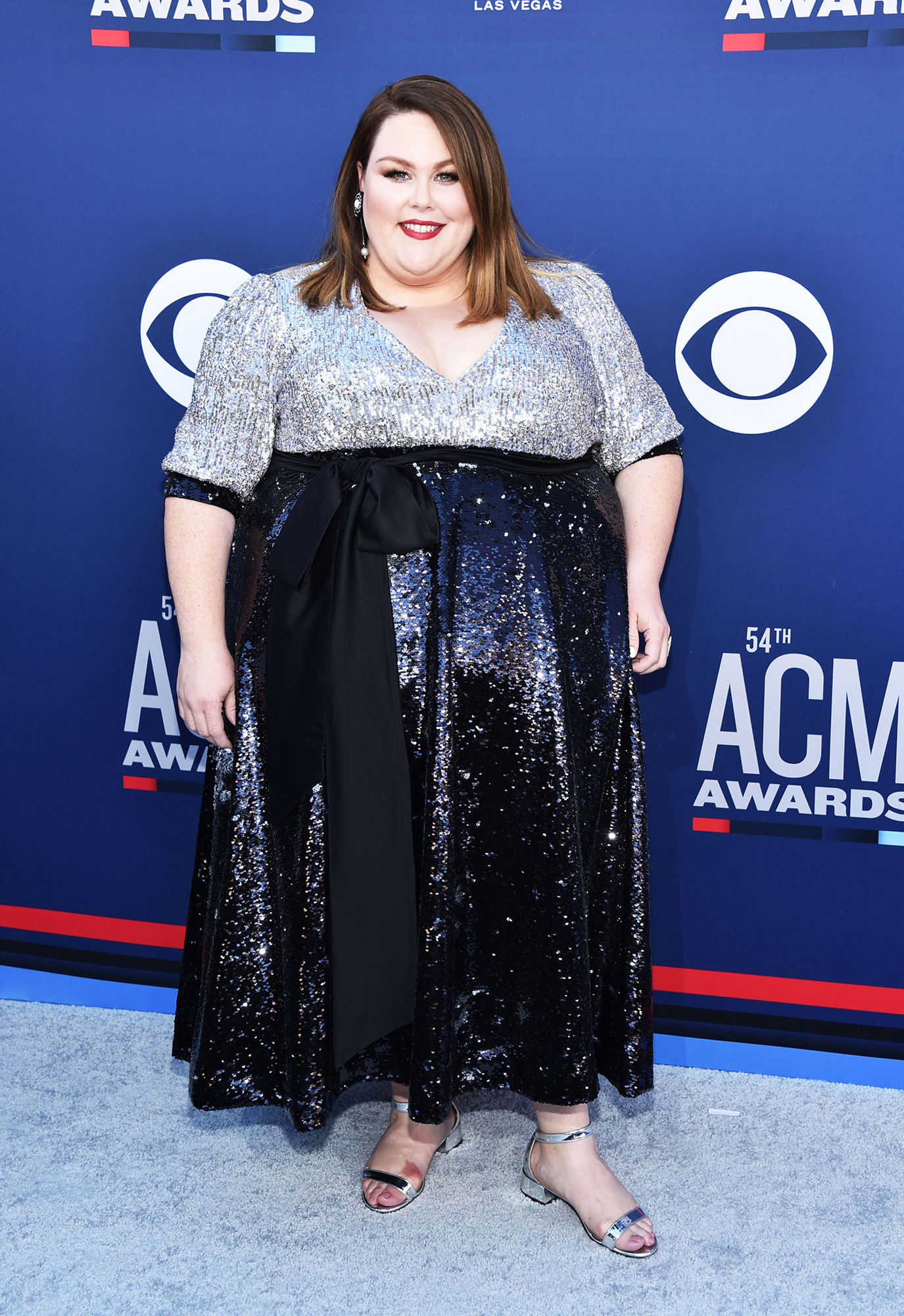 Chrissy Metz The Best Looks From the Country Music Awards Red Carpet - Making her singing debut, the This Is Us actress walked the red carpet in a black and silver sequin gown.