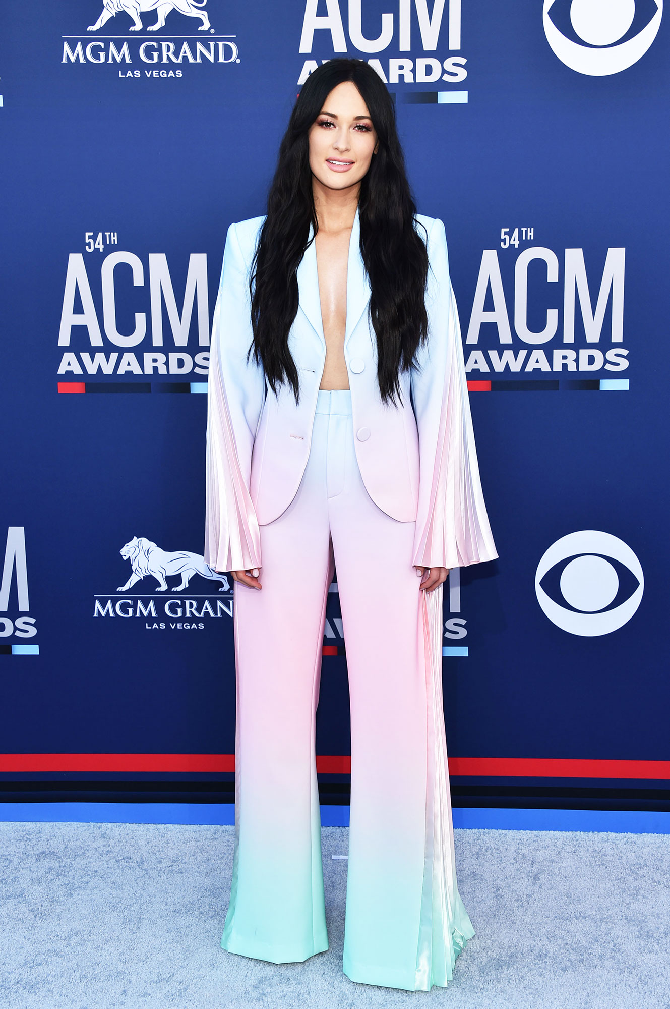 """Kacey Musgraves The Best Looks From the Country Music Awards Red Carpet - Taking home Female Artist of the Year, the """"Golden Hour"""" songwriter was a sight to be seen in her ombre rainbow pastel pantsuit."""
