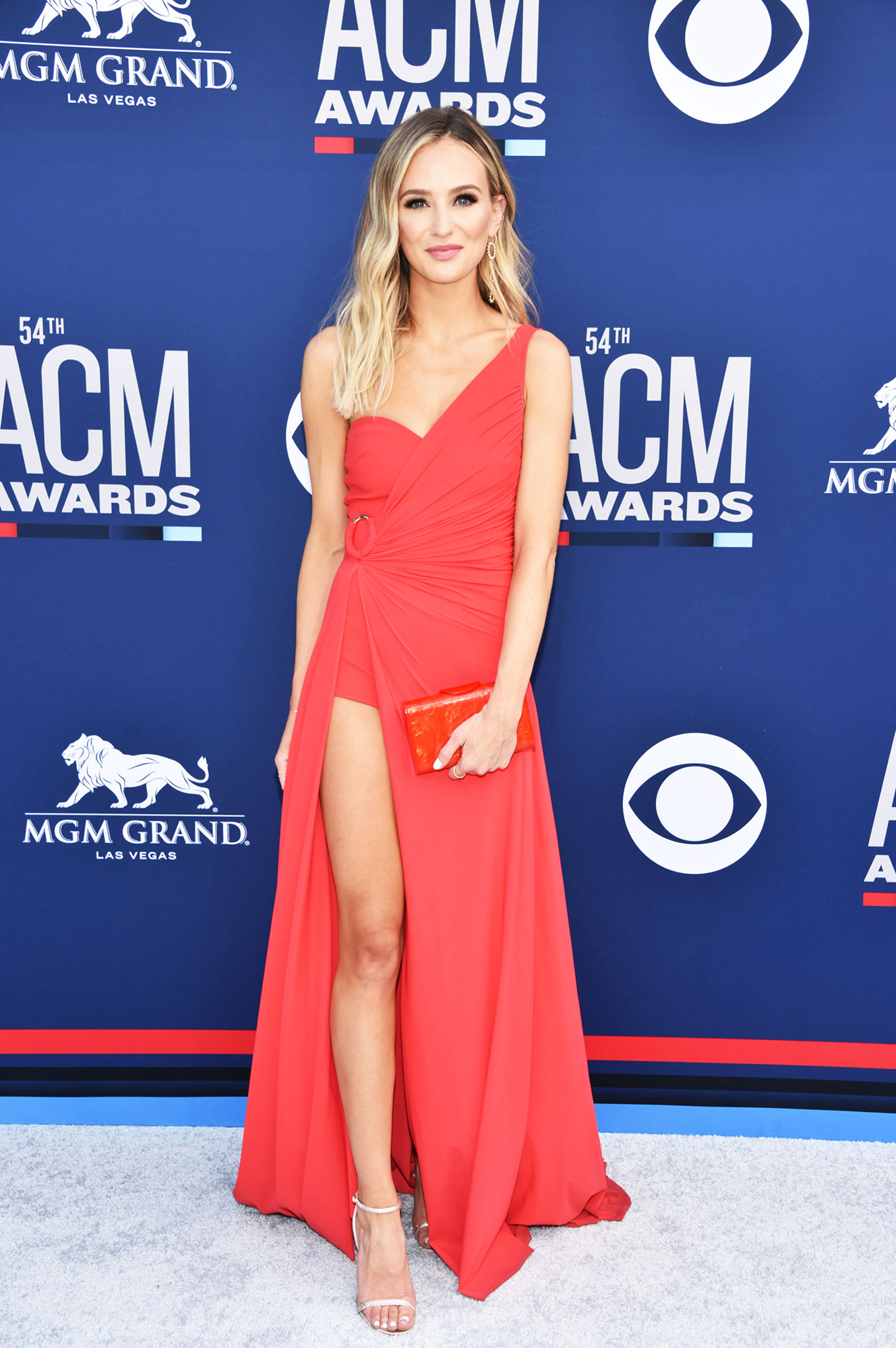 Lauren Bushnell The Best Looks From the Country Music Awards Red Carpet - The Bachelor alumn showed off her long limbs in a red dress with a thigh-high slit.