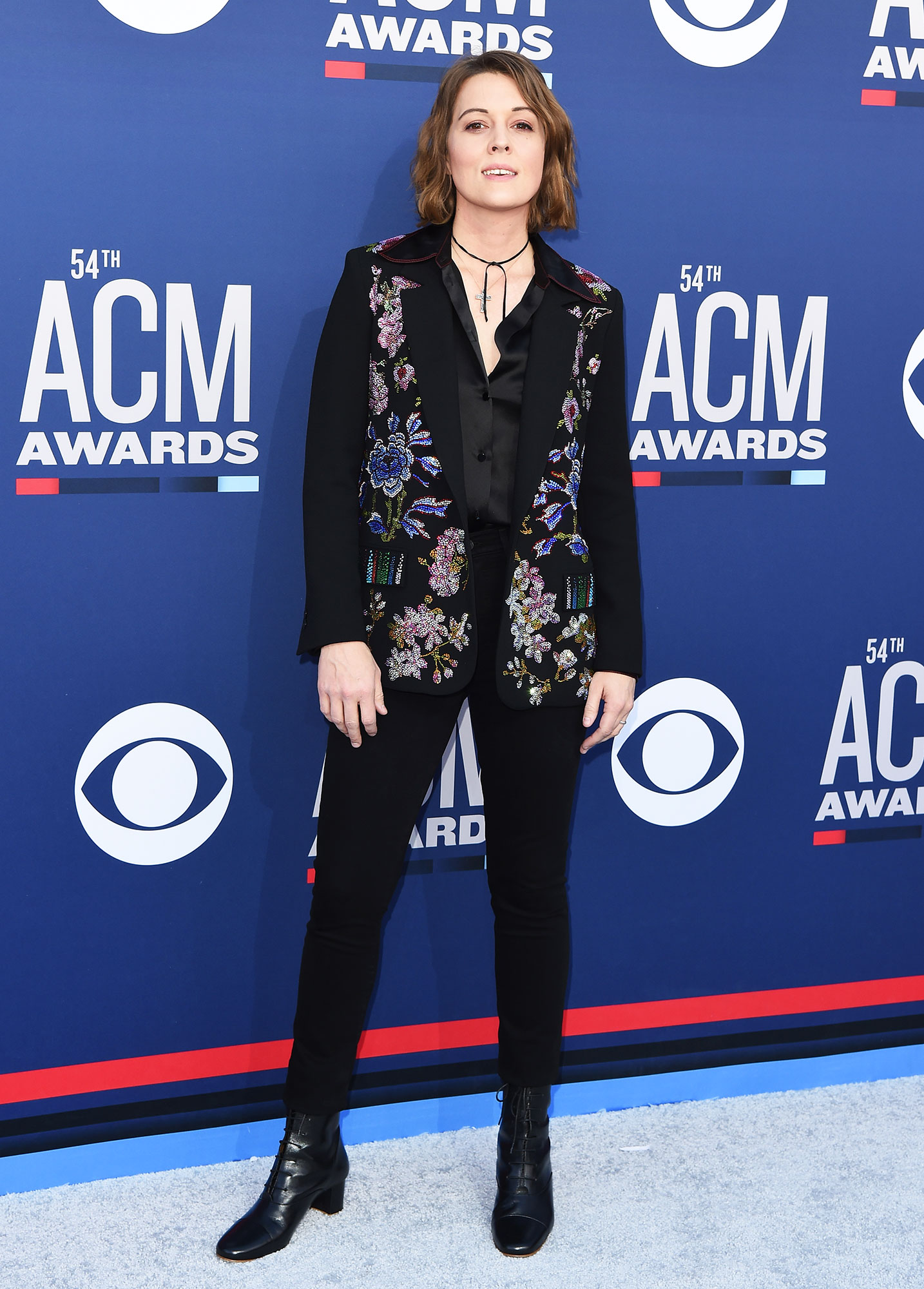 Brandi Carlile The Best Looks From the Country Music Awards Red Carpet - In an embroidered flower jacket, the Grammy Award winner looked sleek in a skinny black pant, boots and blouse combo.